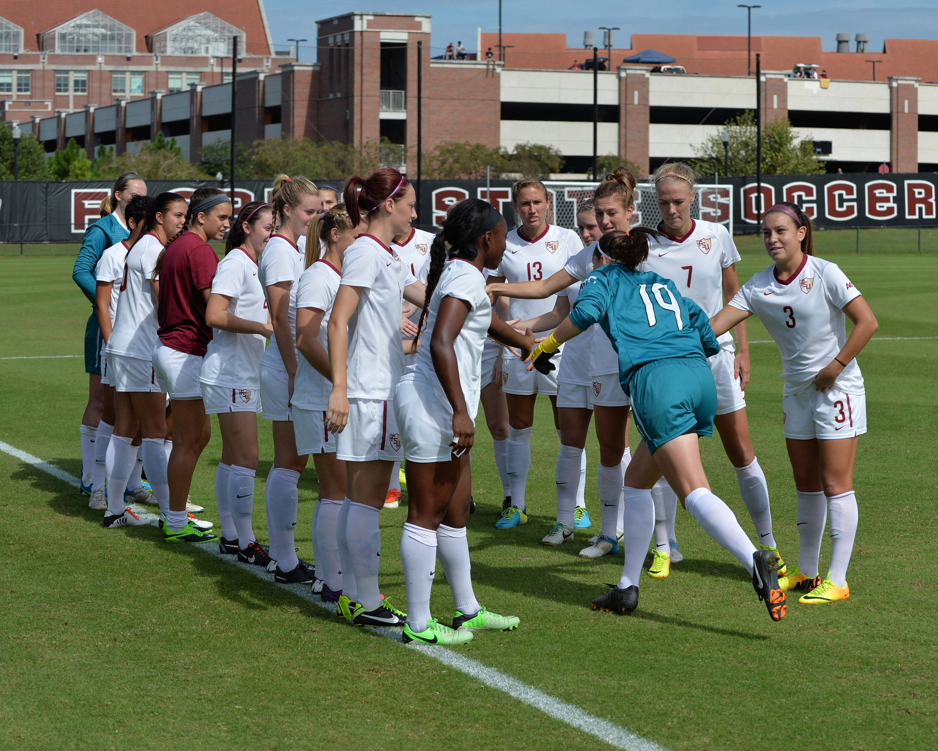 Kelsey Wys runs through the tunnel during Sunday's starting line-ups.