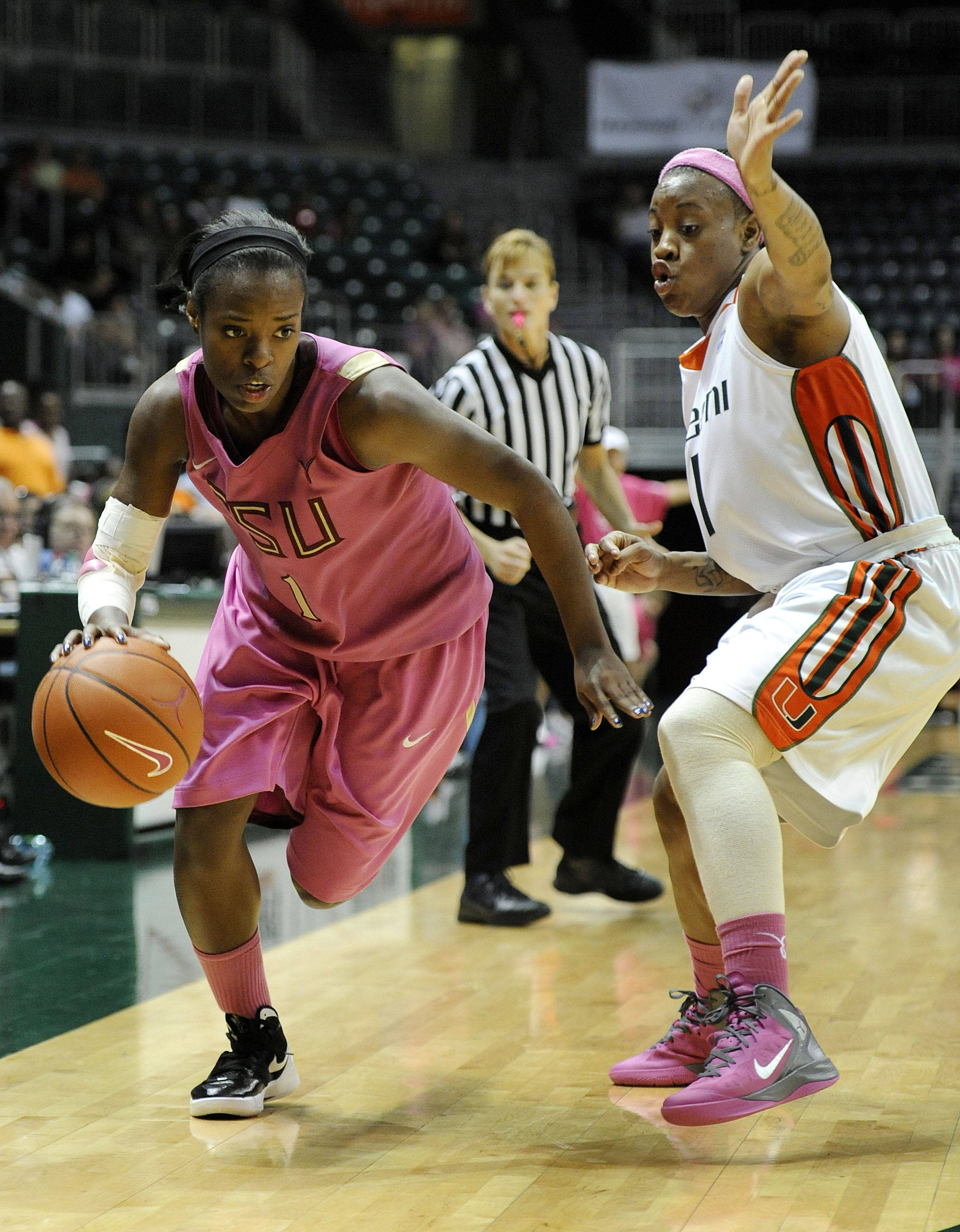 Florida State's Morgan Toles, left, drives the ball past Miami's Riquna Williams, right, during the second half of an NCAA college basketball game on Sunday, Feb. 19, 2012, in Coral Gables, Fla. Miami defeated Florida State 67-60. (AP Photo/Rhona Wise)