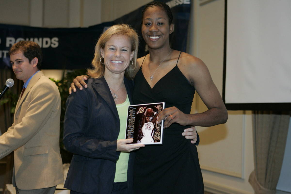 Coach Sue and Alicia Gladden, the recipient of the Most Valuable Offensive Player Award.