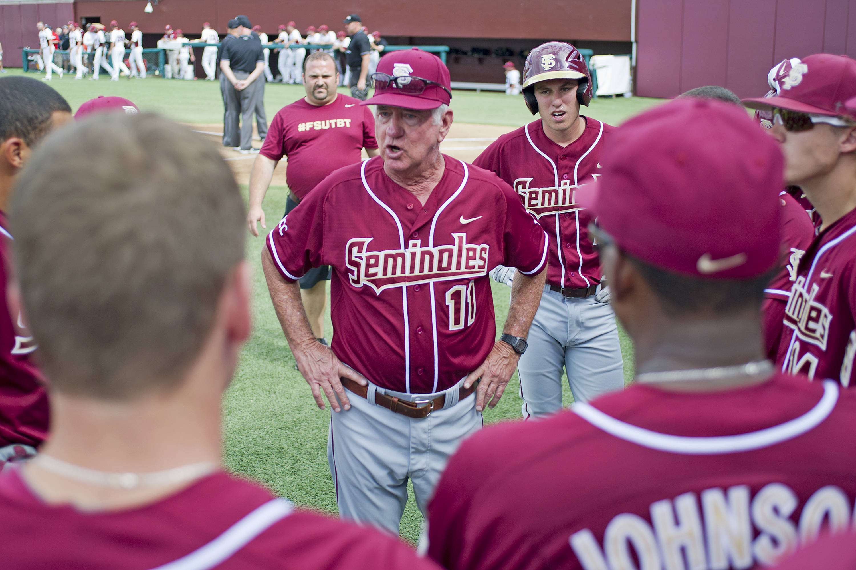 Mike Martin (11) addresses the team before the start of the game