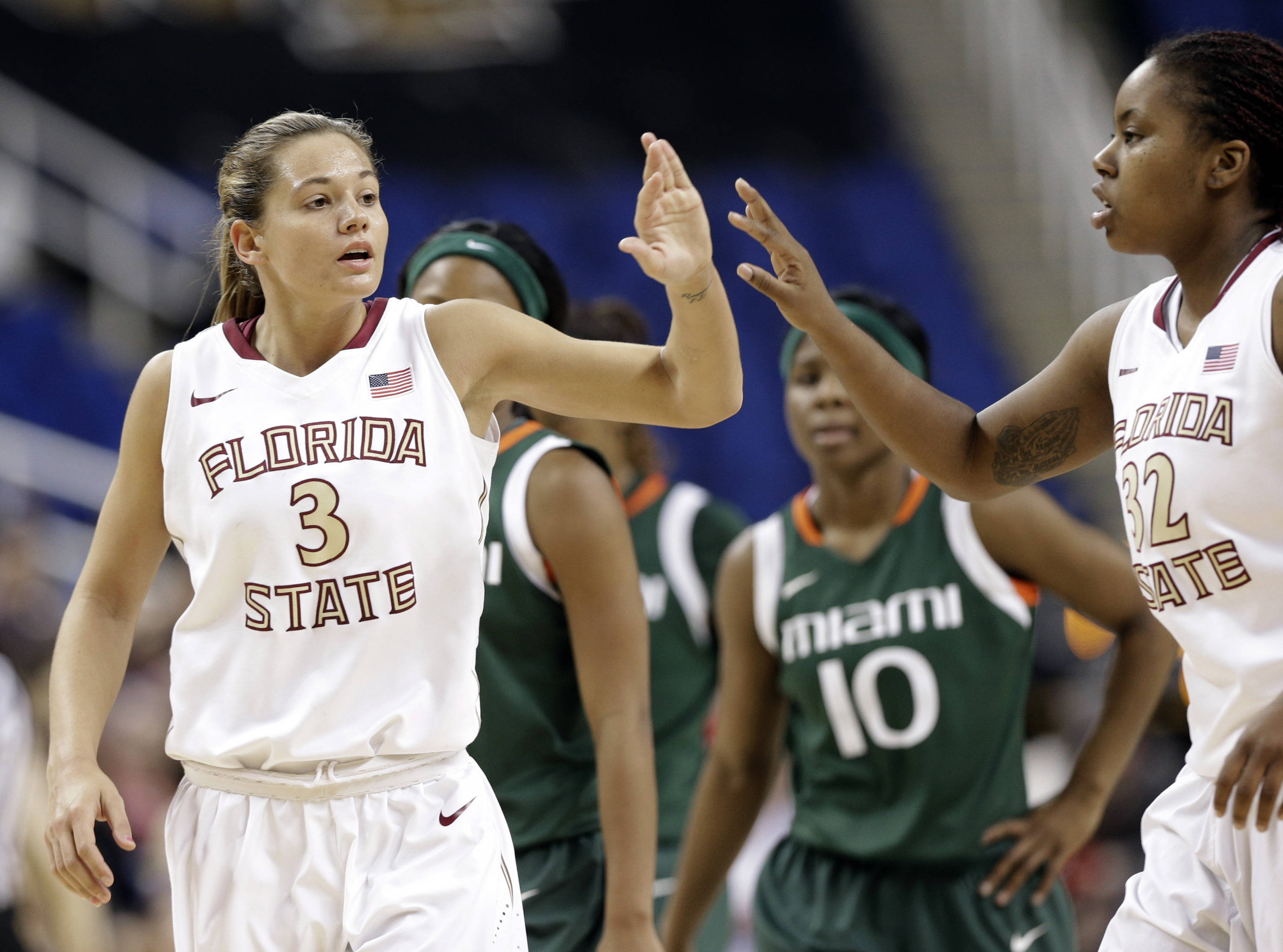 Florida State's Alexa Deluzio (3) is congratulated by teammate Lauren Coleman (32). (AP Photo/Chuck Burton)