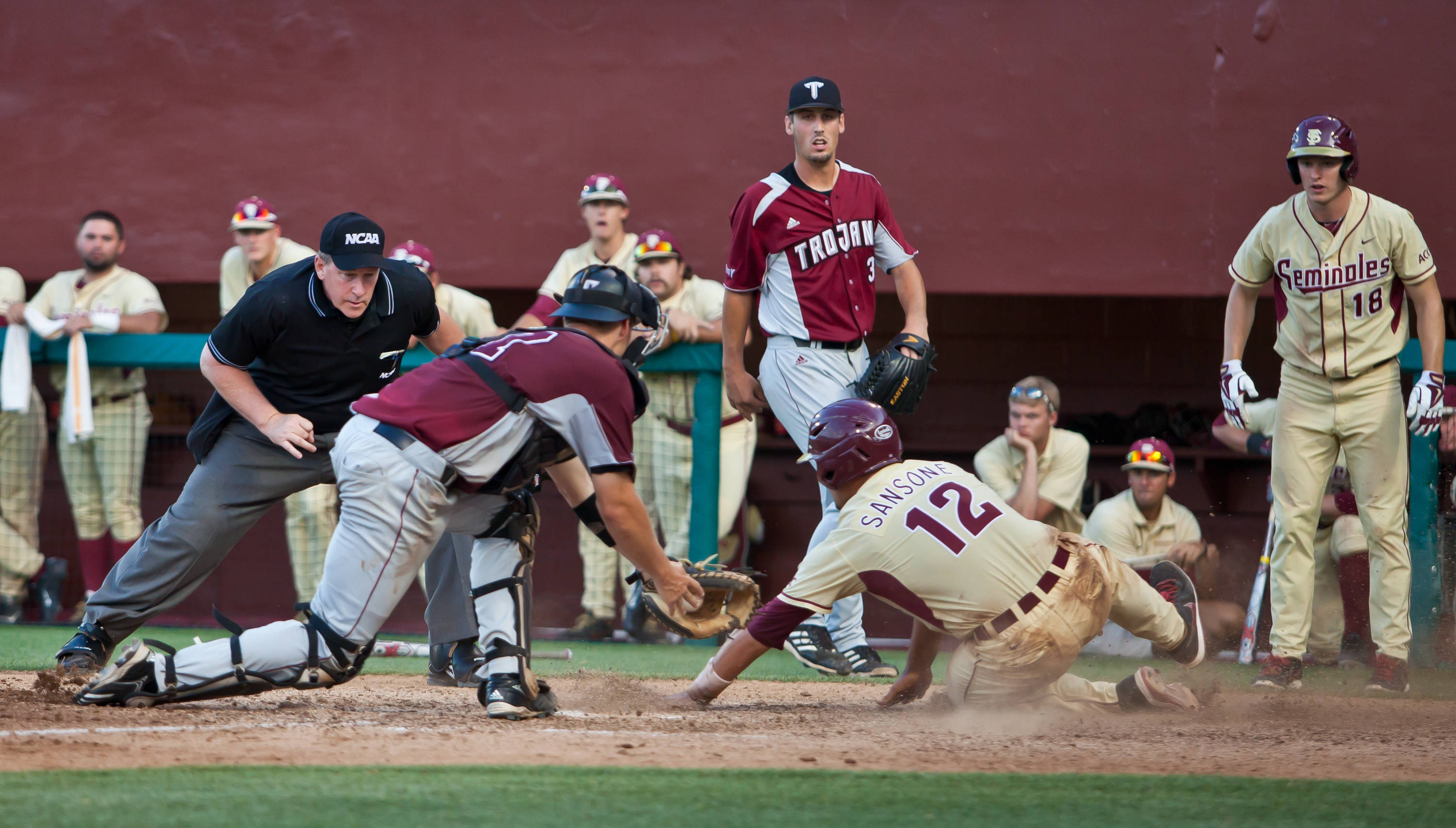 John Sansone slides ahead of the tag in the seventh inning.