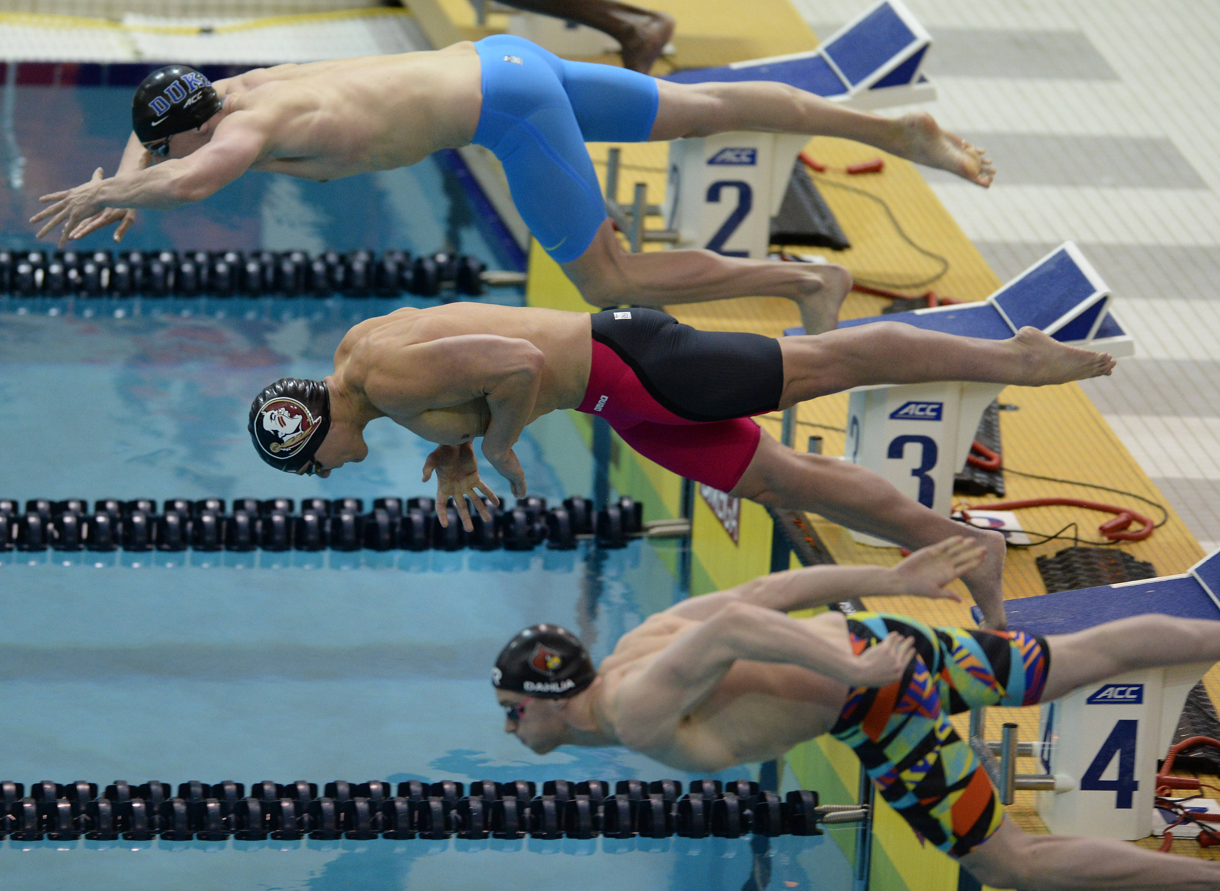 Jason McCormick gets off the blocks in the 50 free - Mitch White