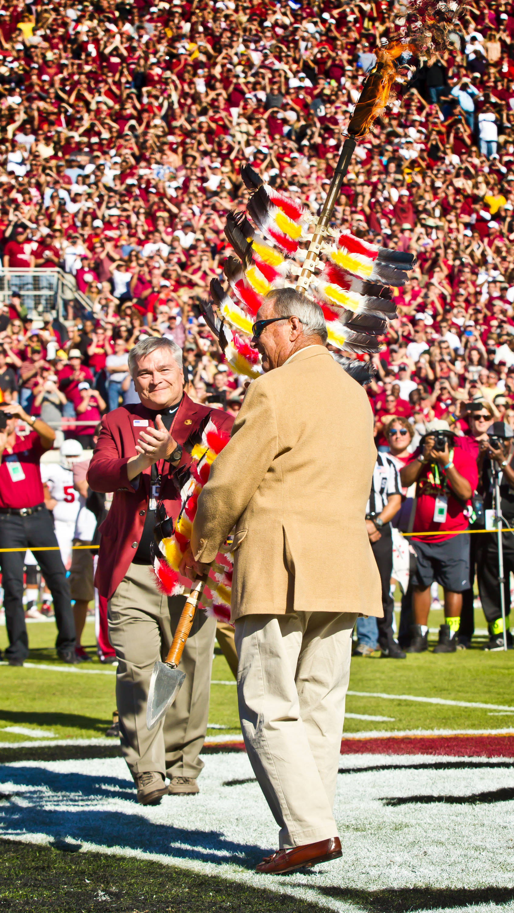 President Eric Barron hands off Osceola's spear to Coach Bowden.