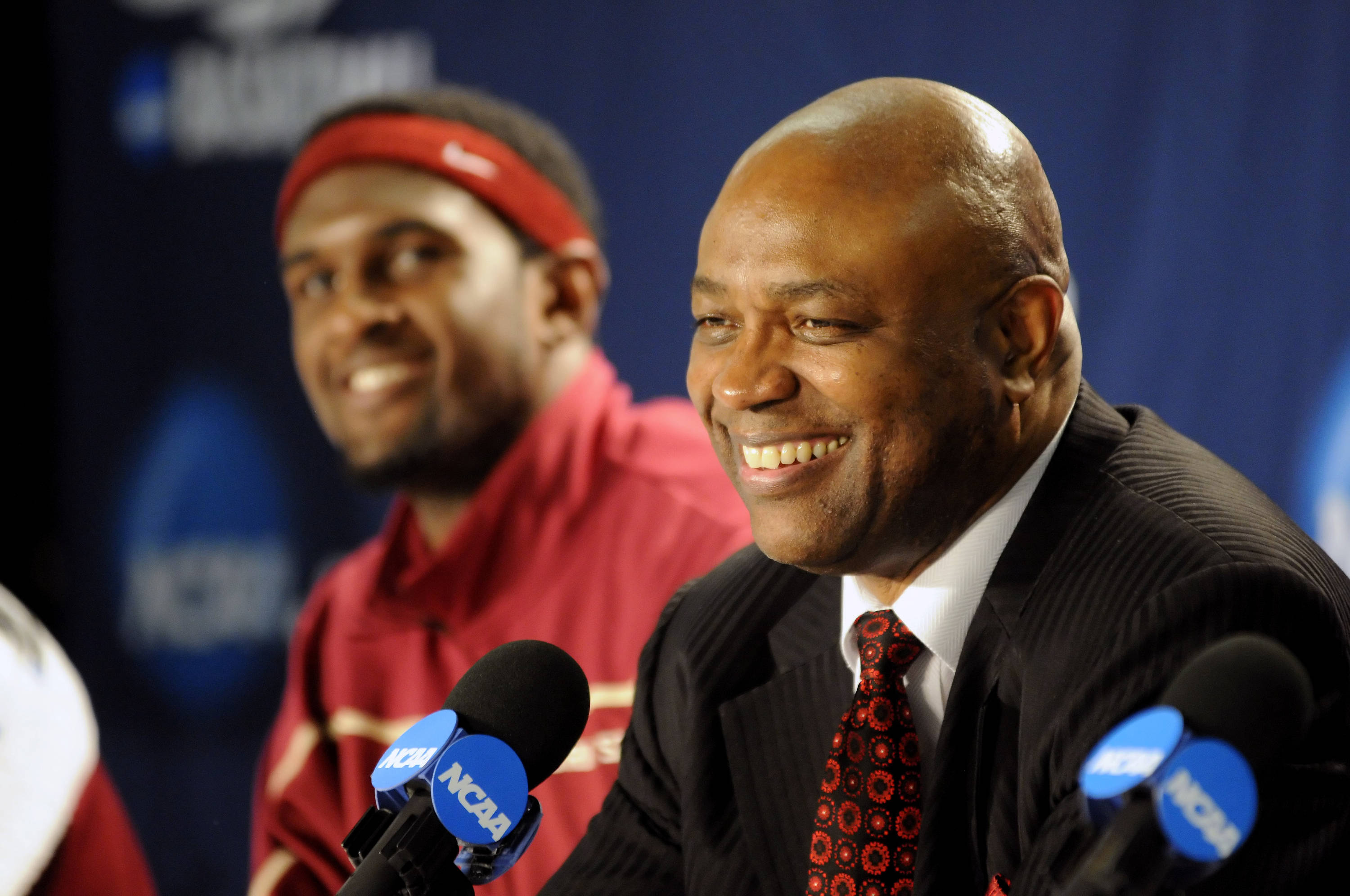 A smiling Leonard Hamilton answers questions at the post game press conference
