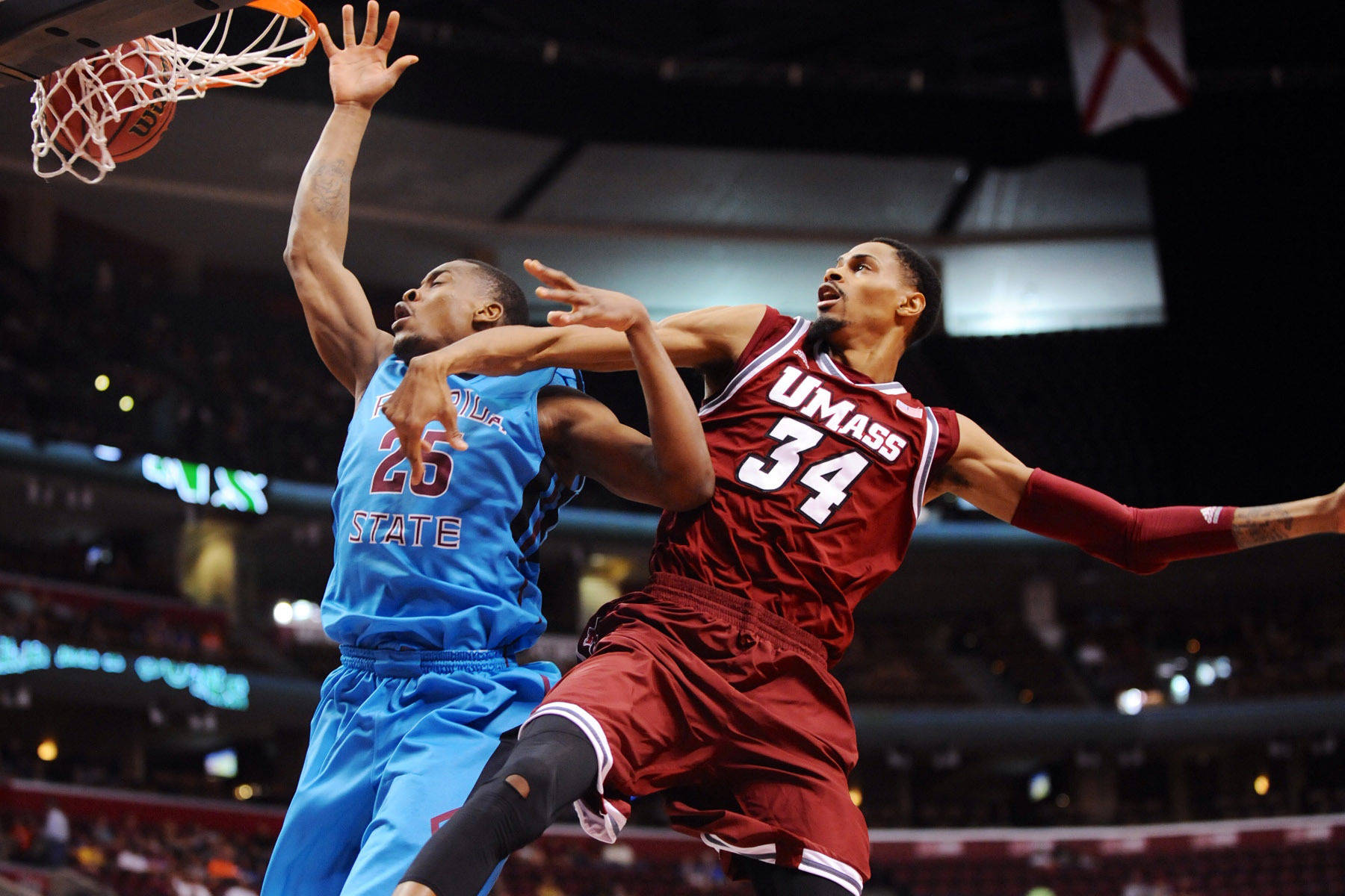 Dec 21, 2013; Sunrise, FL, USA; Florida State Seminoles guard Aaron Thomas (25) is fouled by Massachusetts Minutemen forward Raphiael Putney (34) during the first half at BB&T Center. Mandatory Credit: Steve Mitchell-USA TODAY Sports