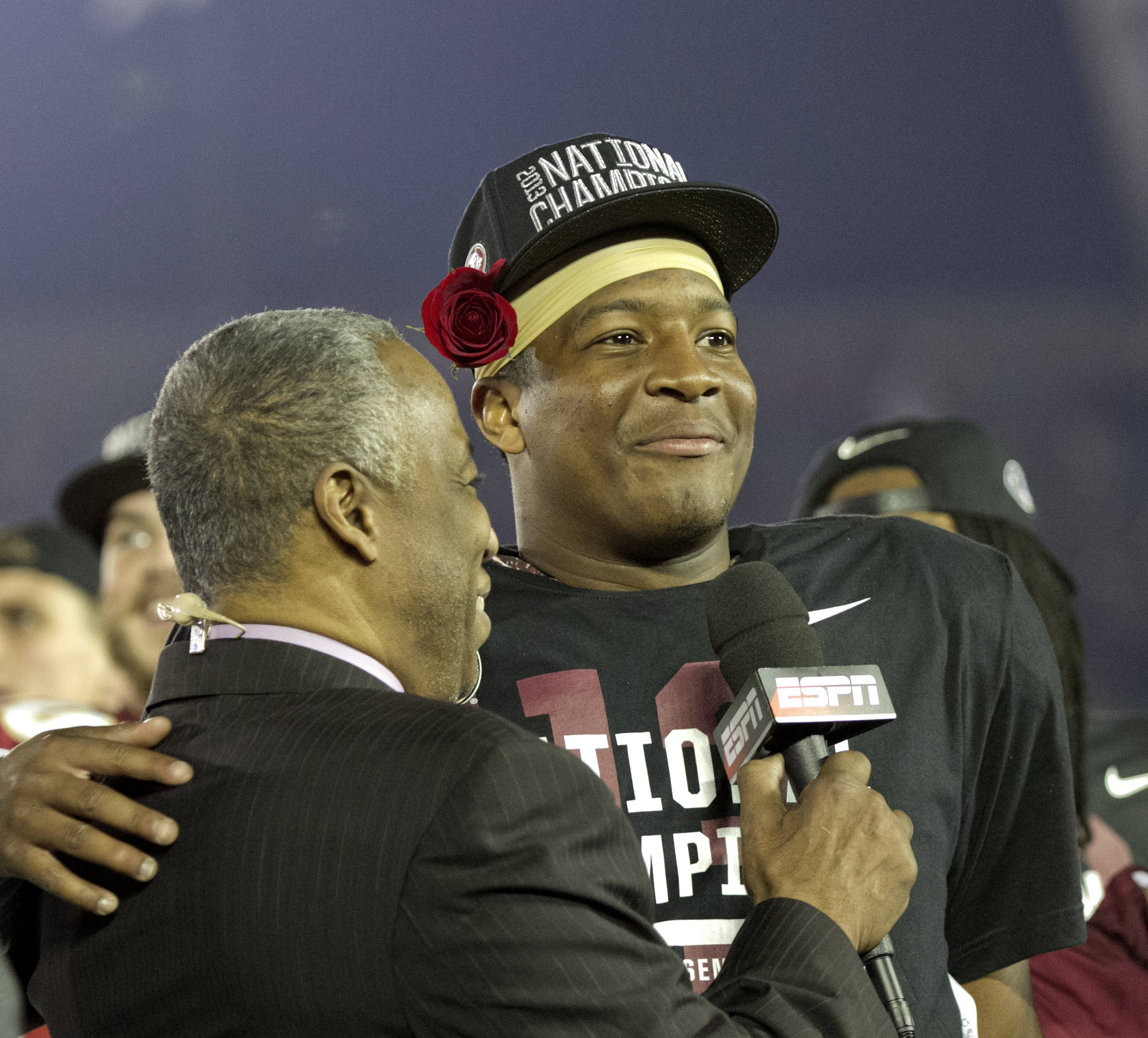 Heisman Trophy winner and BCS Championship MVP celebrating a moment with announcer Jon Saunders, BCS Championship, FSU vs Auburn, Rose Bowl, Pasadena, CA,  1-06-14,  (Photo by Steve Musco)