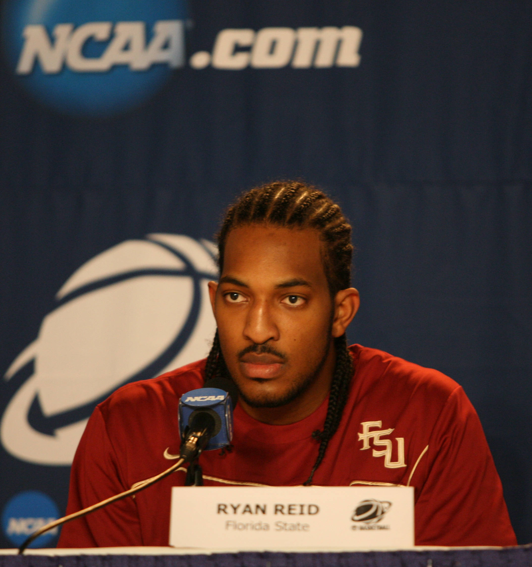 Senior captain Ryan Reid takes questions at the NCAA Tournament press conference.