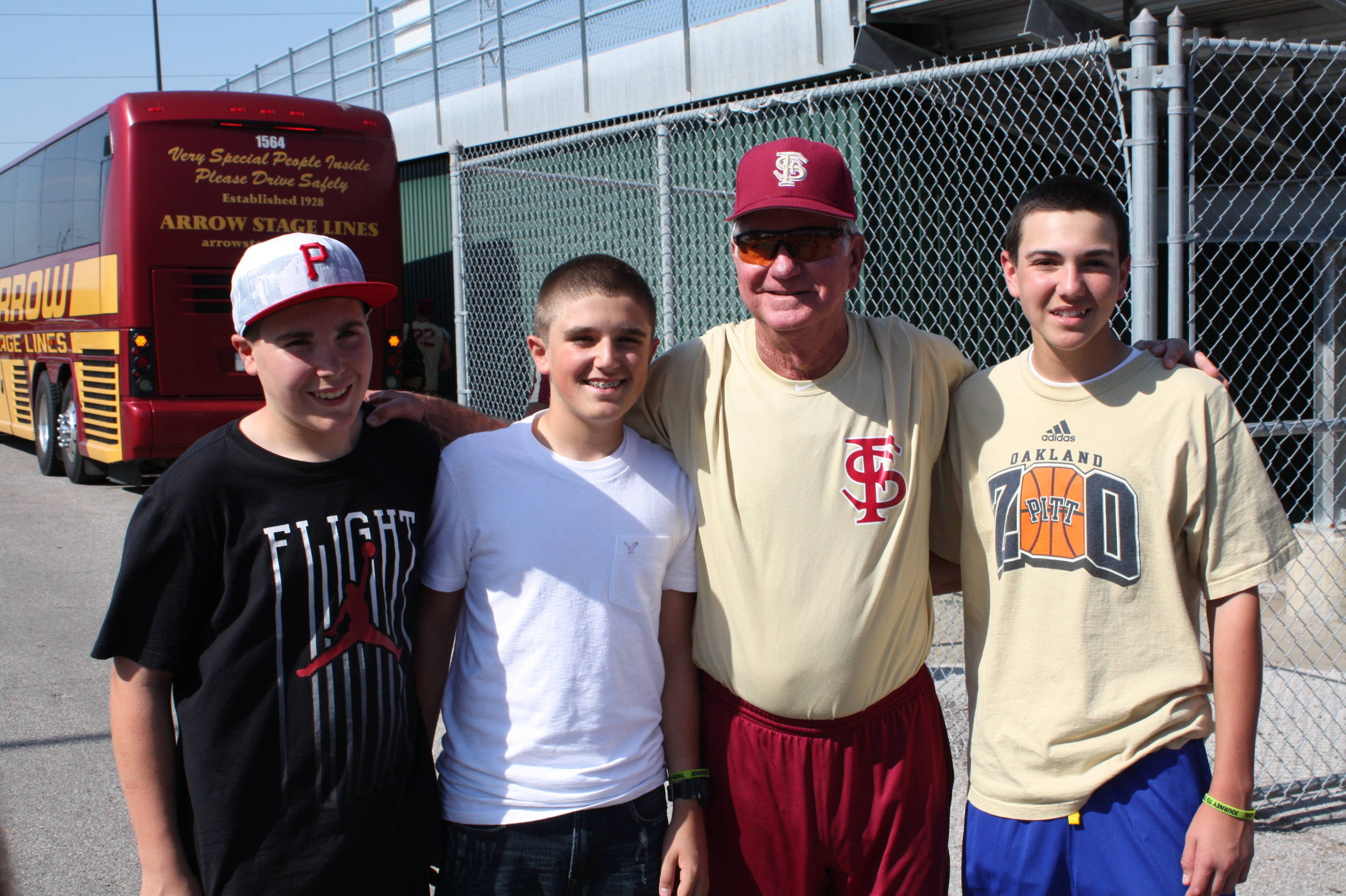 Head coach Mike Martin poses with fans