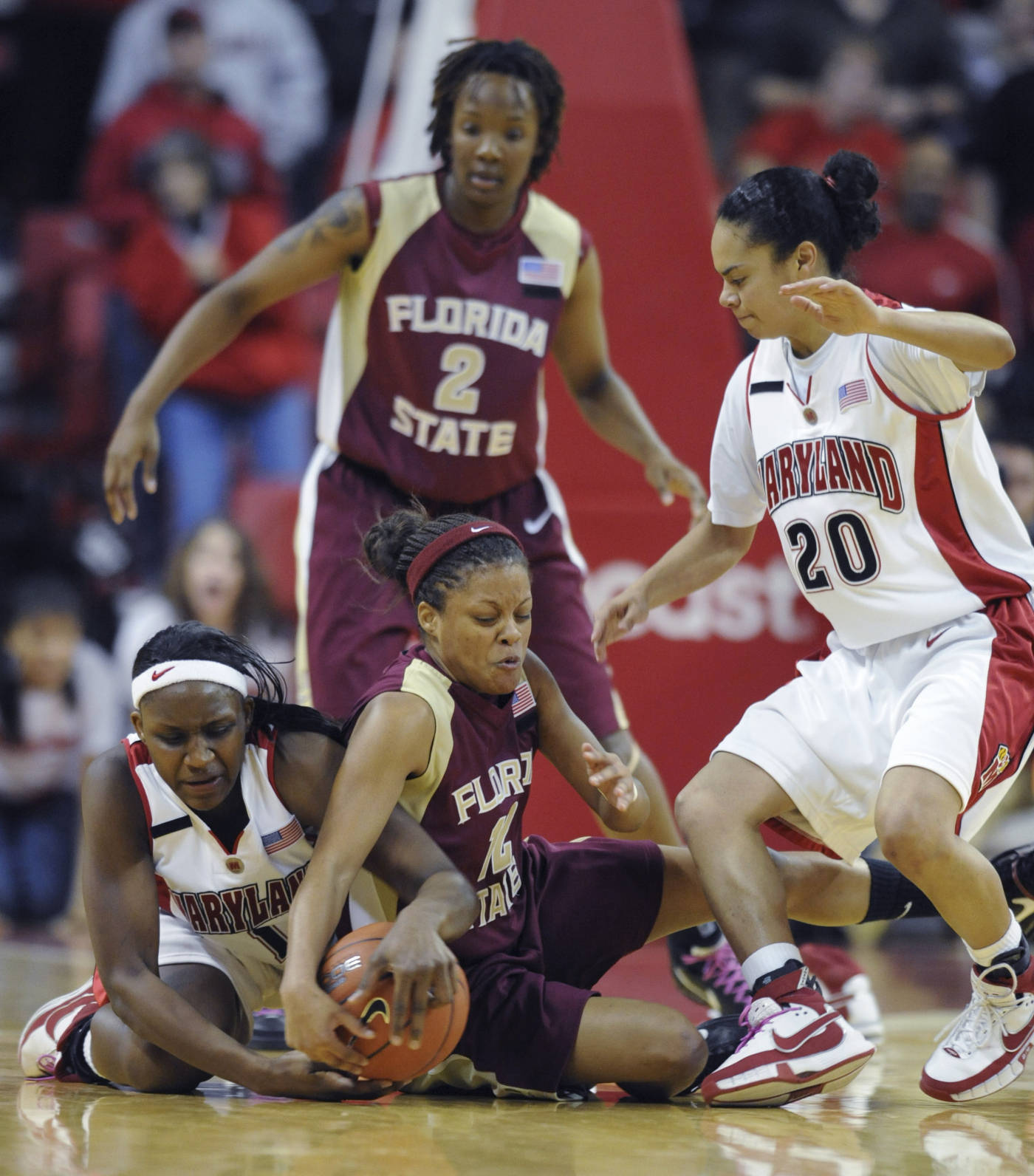 Maryland's Crystal Langhorne, left, and Florida State's Courtney Ward struggle for a loose ball during the first half of a college basketball game Sunday, Feb. 24, 2008 in College Park, Md. Also pictured is Maryland's Kristi Toliver, (20), and Alysha Harvin. Maryland won 92-84 in overtime. (AP Photo/Gail Burton)