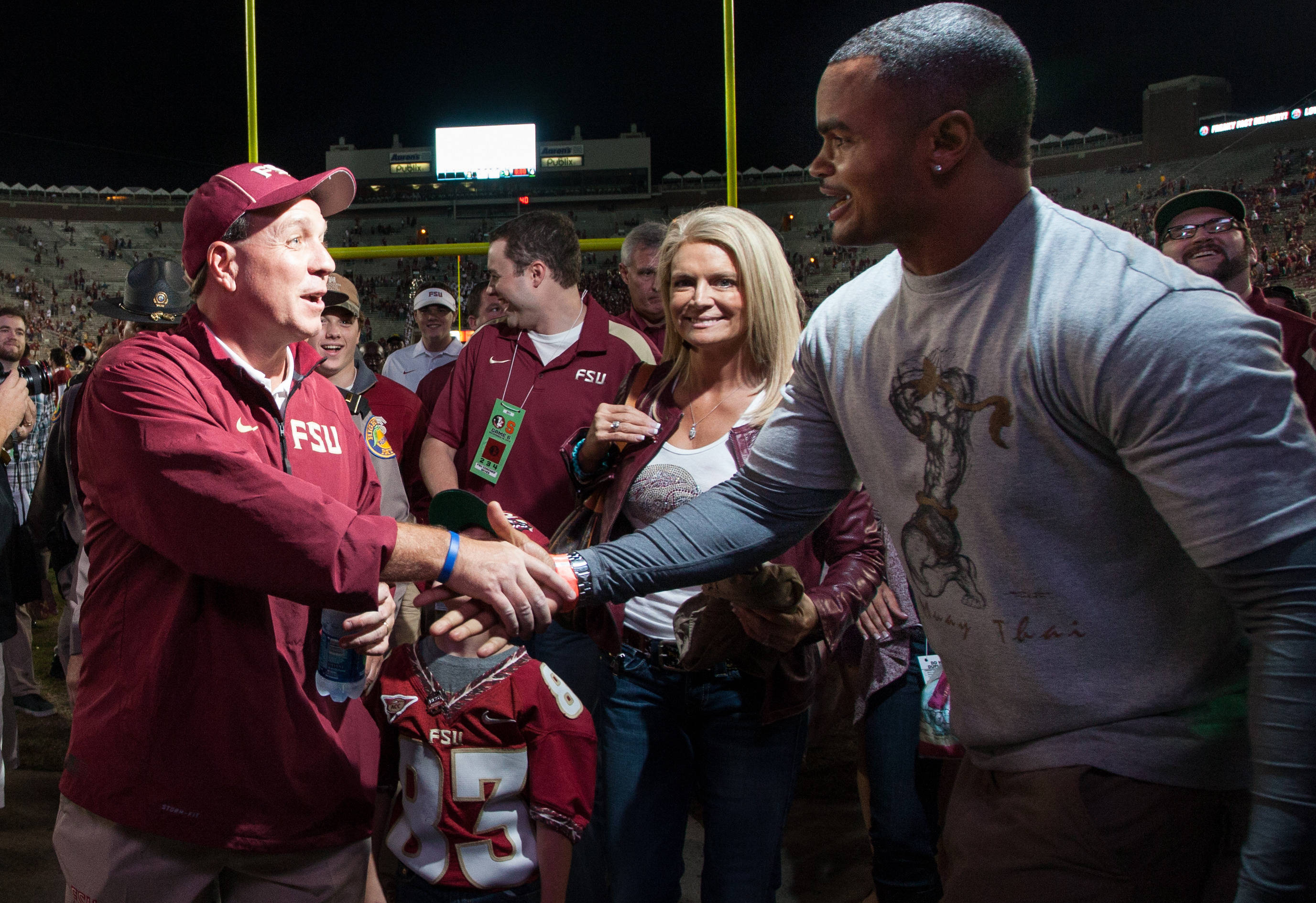 Jimbo Fisher shakes hands with Jamal Reynolds after FSU Football's 59-3 win over Syracuse on Saturday, November 16, 2013 in Tallahassee, Fla. Photo by Mike Schwarz.