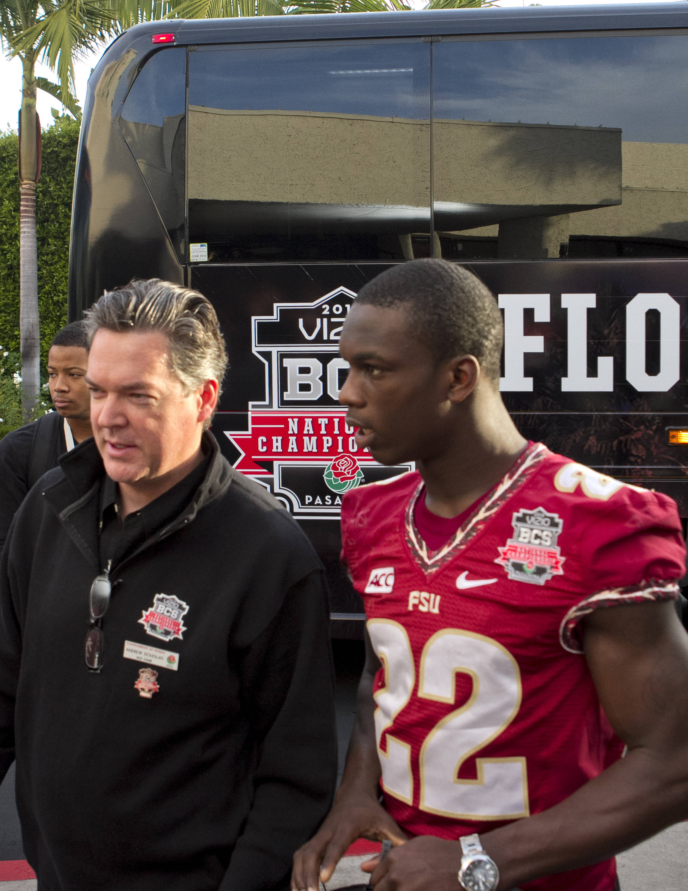 Telvin Smith (22) being escorted into the hotel for media day, FSU at BCS Championship Media Day,  1-04-14,  (Photo by Steve Musco)