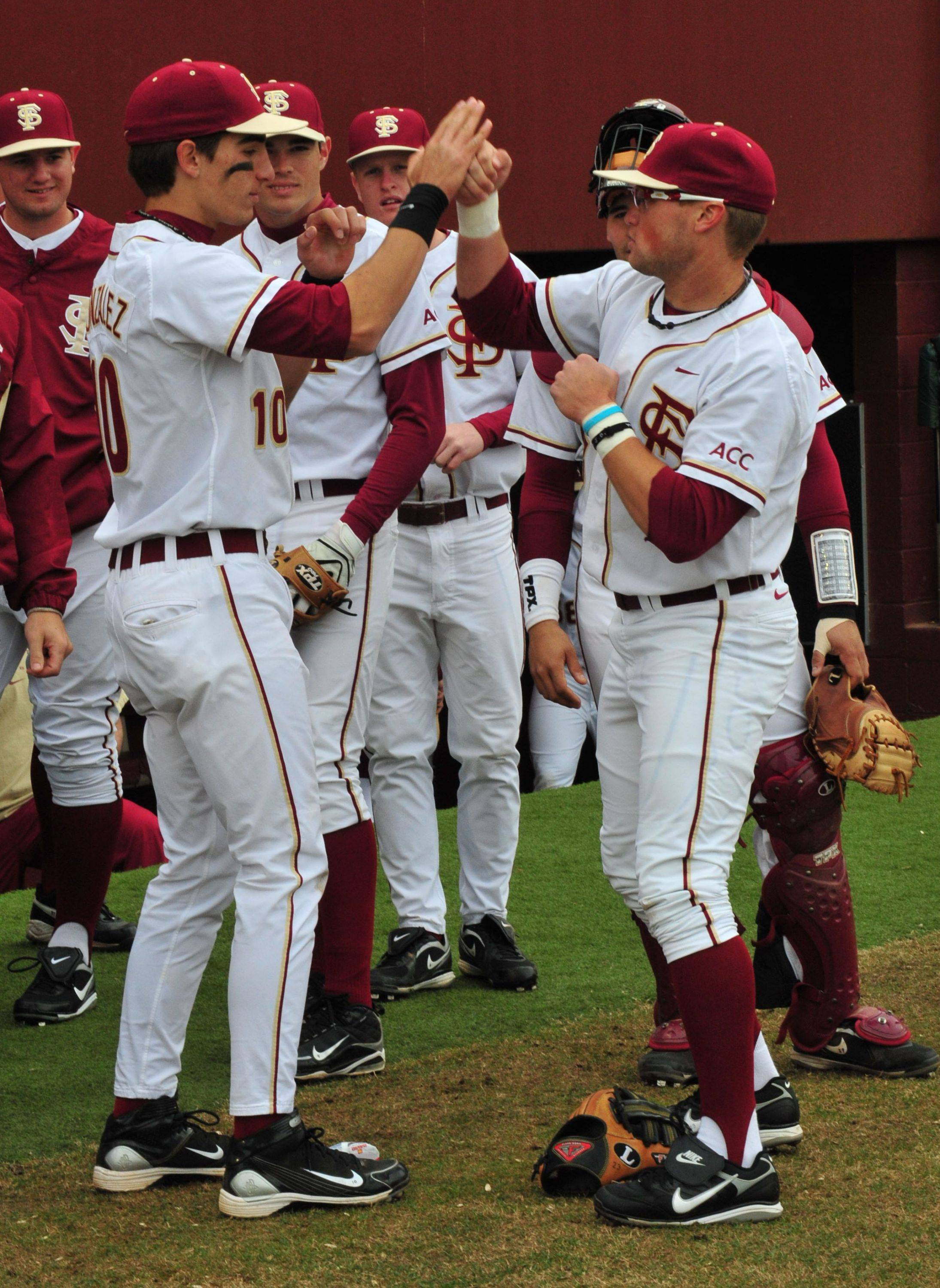Justin Gonzalez and James Ramsey display their pre-game handshake.