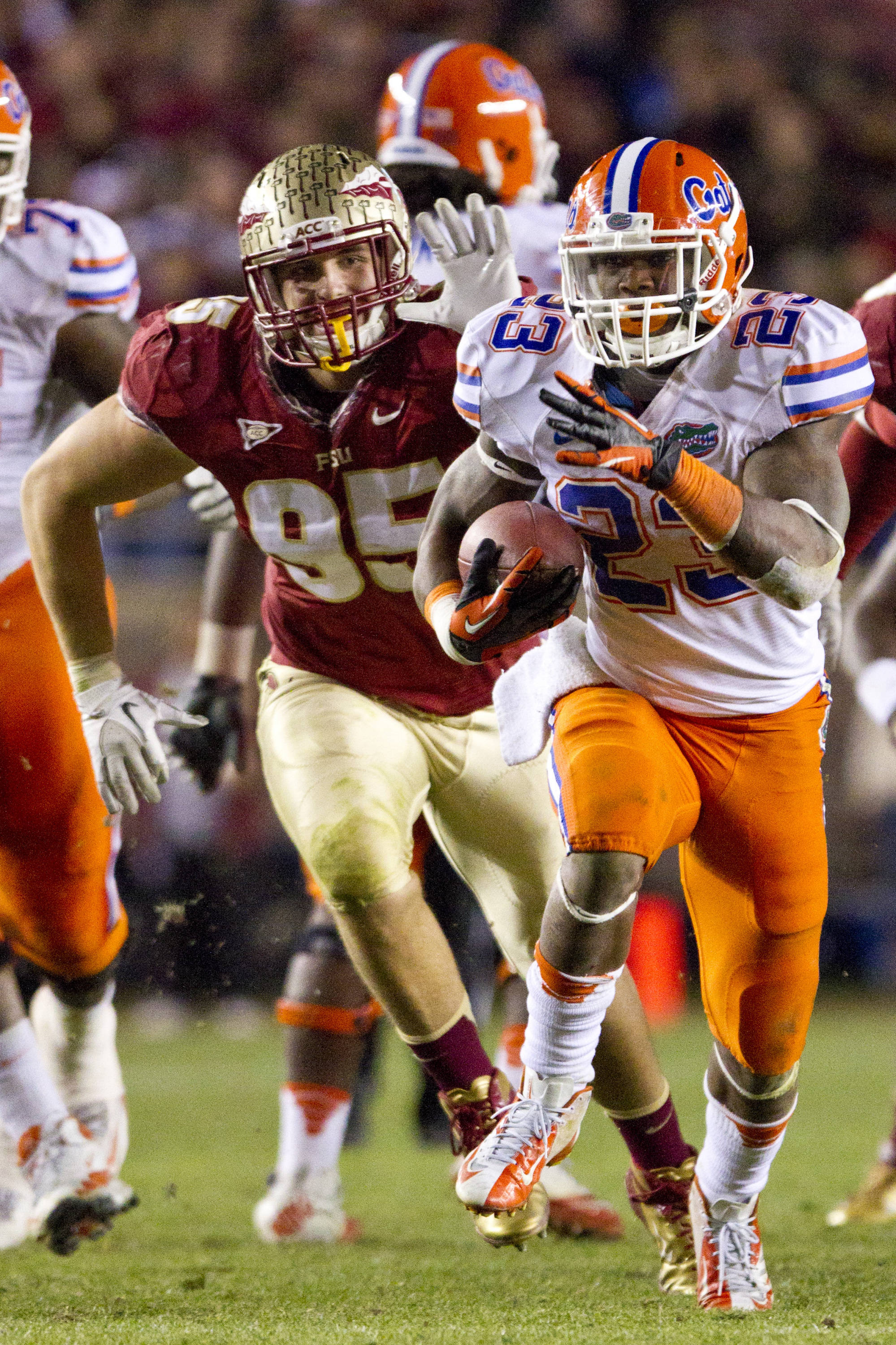 Bjoern Werner (95) tries to catch a UF ball carrier during FSU Football's game against UF on Saturday, November 24, 2012 in Tallahassee, Fla.