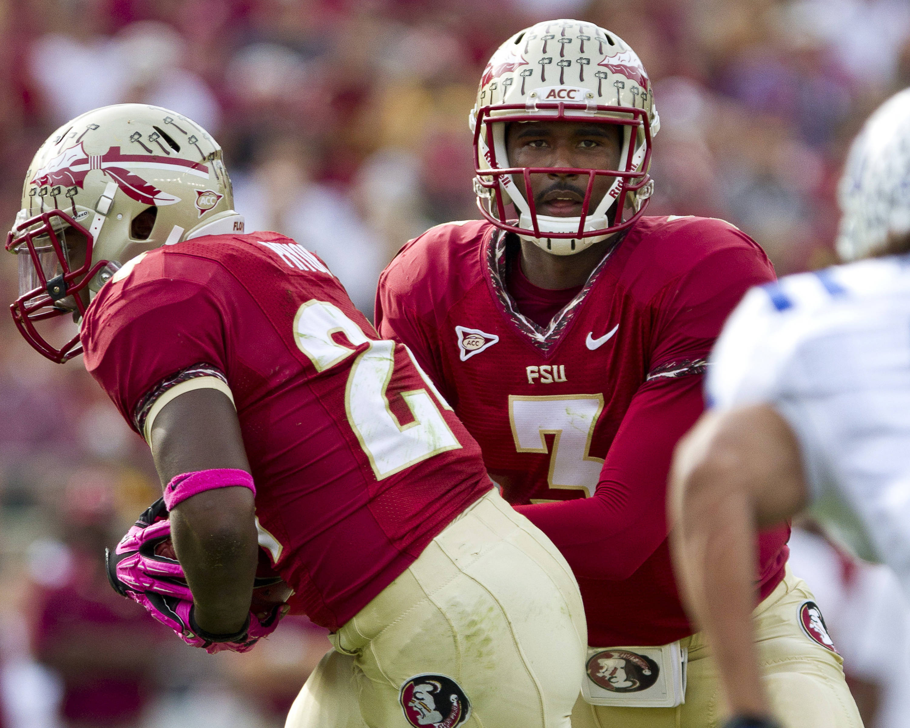 EJ Manuel (3) hands the ball off to Lonnie Pryor (24) during FSU's 48-7 victory over Duke on October 27, 2012 in Tallahassee, Fla.