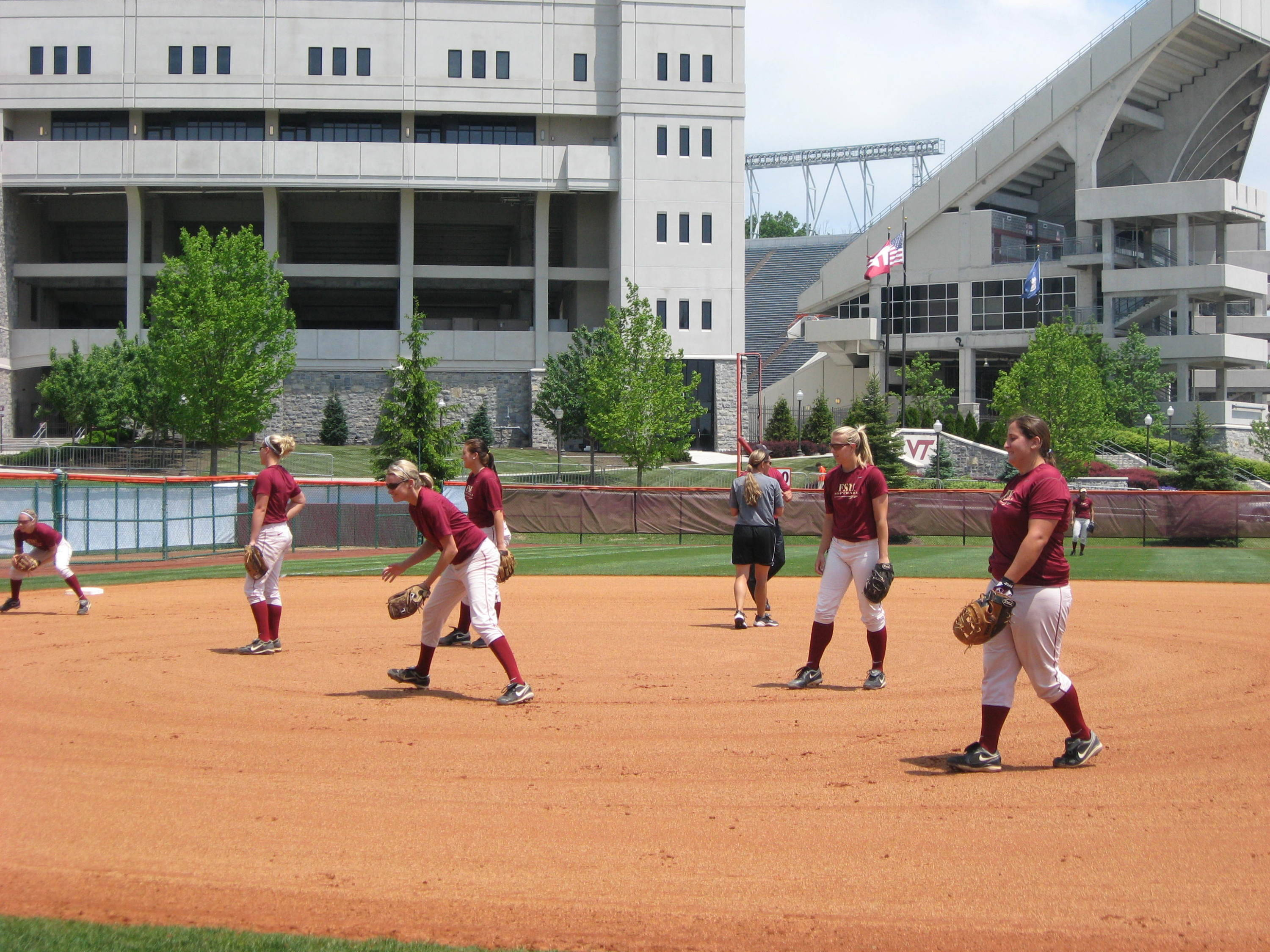 Sarah Hamilton, Tory Haddad and others practice on Thursday afternoon at Tech Softball Park.
