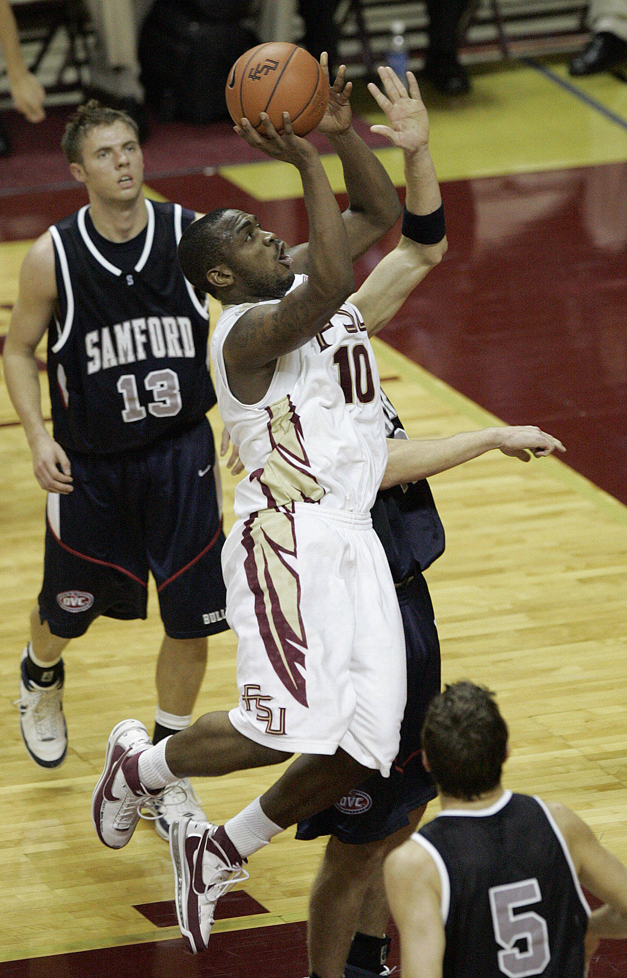 Florida State's Ralph Mims splits the Samford defense to score in the second half of a college basketball game which FSU won 61-45 on Sunday Dec. 2, 2007, in Tallahassee, Fla. (AP Photo/Steve Cannon)