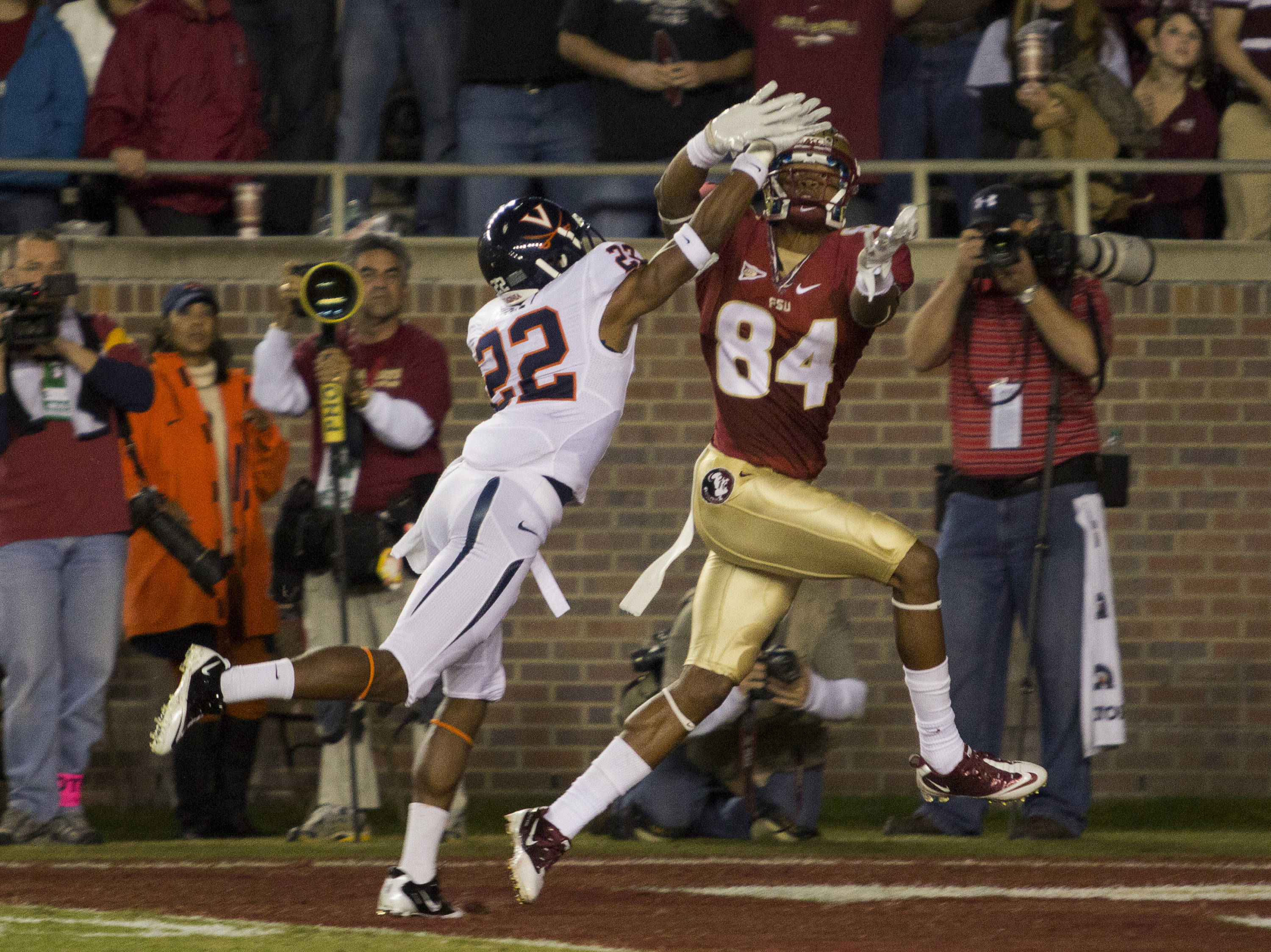 Rodney Smith (84) attempts to see past a defender's hand to catch a pass during the game against Virginia on November 29, 2011.  The pass was incomplete.