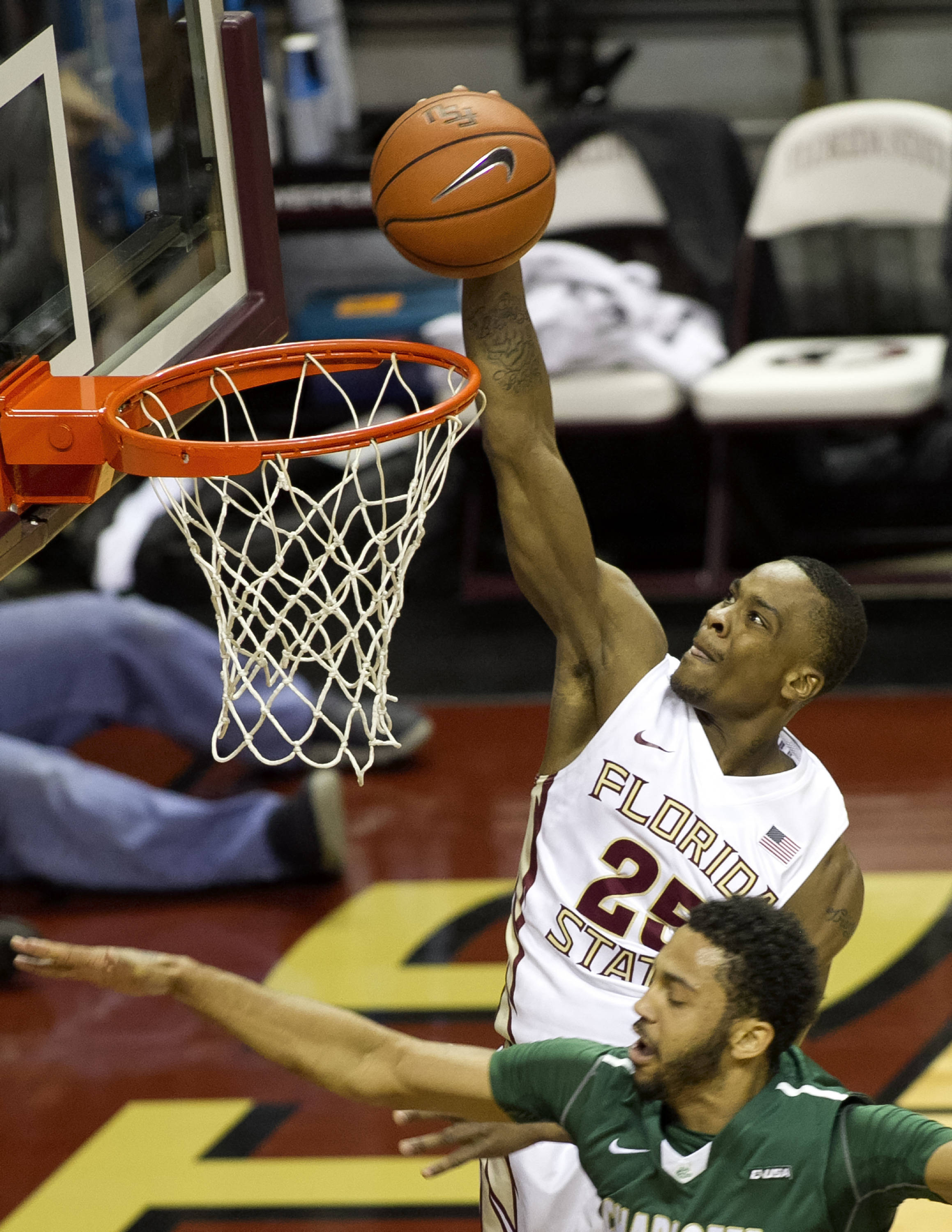 Aaron Thomas (25) with 2 of his 22 first half points, FSU vs Charlotte, 12-17-13,  (Photo by Steve Musco)