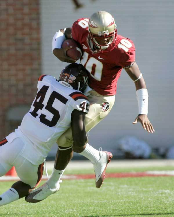 Florida State quarterback D'Vontrey Richardson, right, is tackled by Virginia Tech linebacker Purnell Sturdivant during the first quarter.