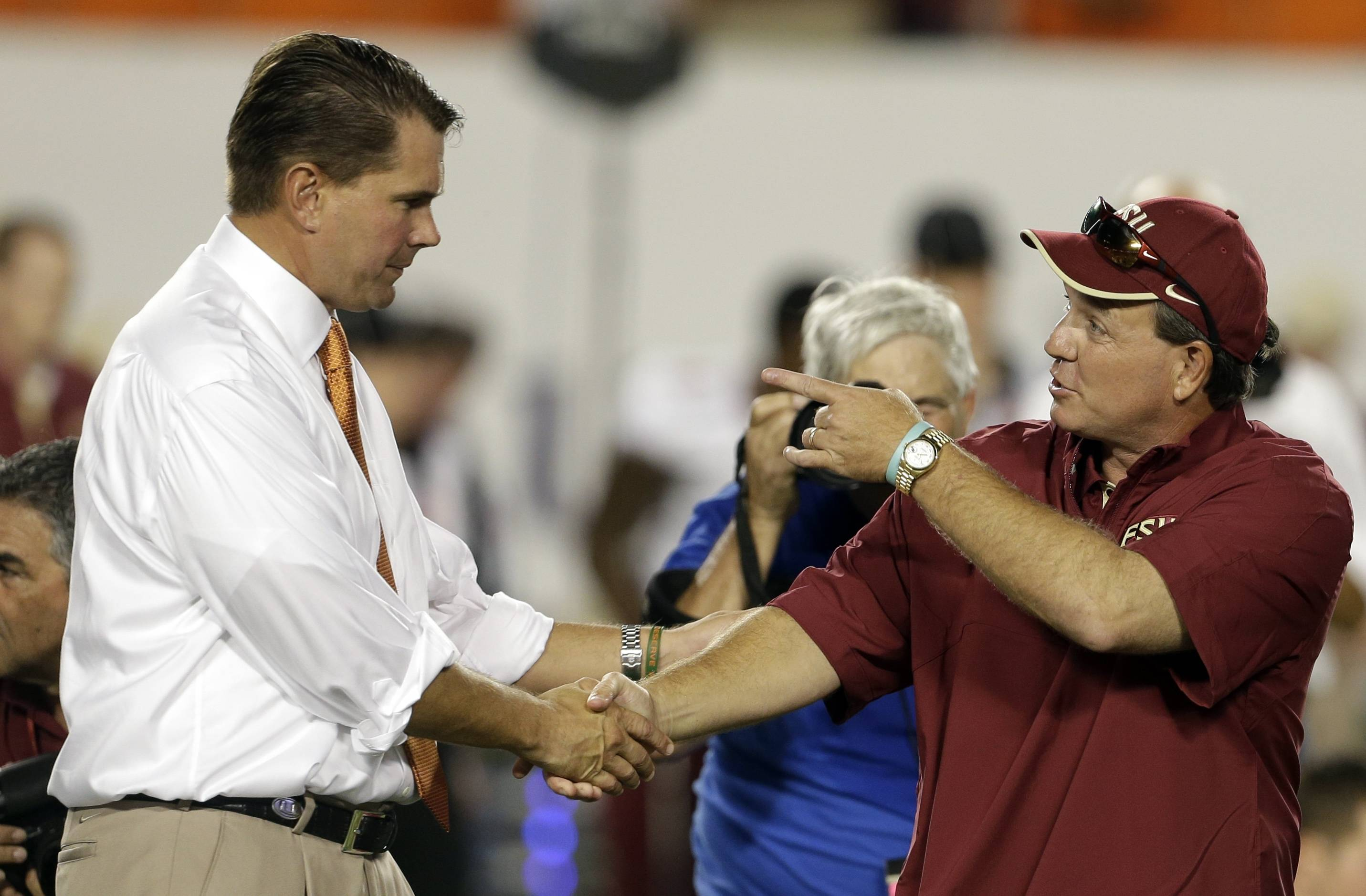 Miami's head coach Al Golden, left, shakes hands with Florida State's head coach Jimbo Fisher, right, before an NCAA college football game, Saturday, Oct. 20, 2012, in Miami. (AP Photo/Lynne Sladky)