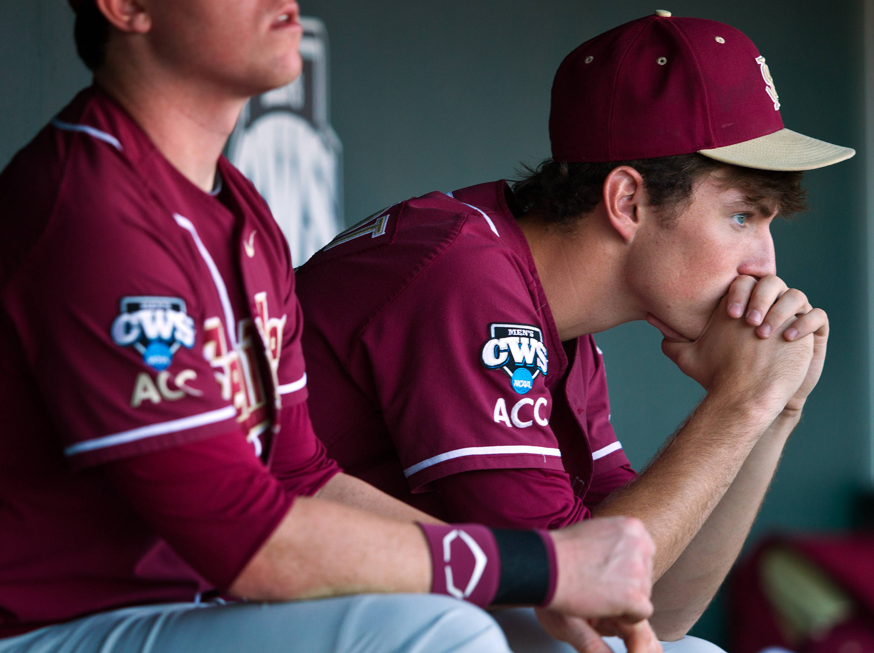 Florida State starting pitcher Brandon Leibrandt, right, watches the end of the game from the dugout as Arizona wins 10-3. (AP Photo/Omaha World-Herald, Rebecca S. Gratz)