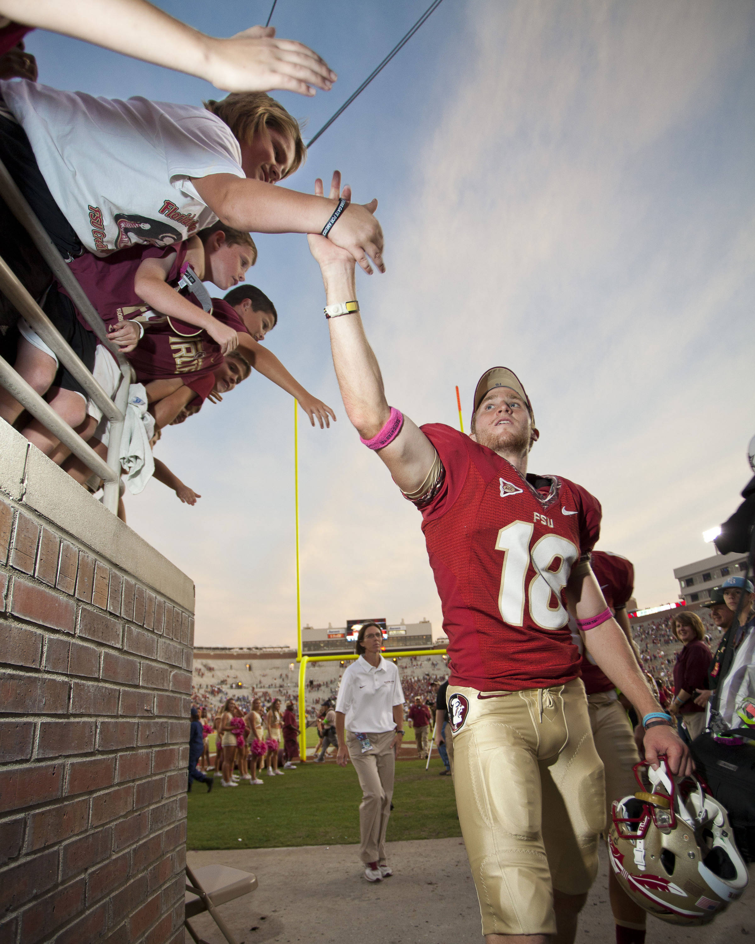 Dustin Hopkins (18) high-fives fans after FSU's 48-7 victory over Duke on October 27, 2012 in Tallahassee, Fla.