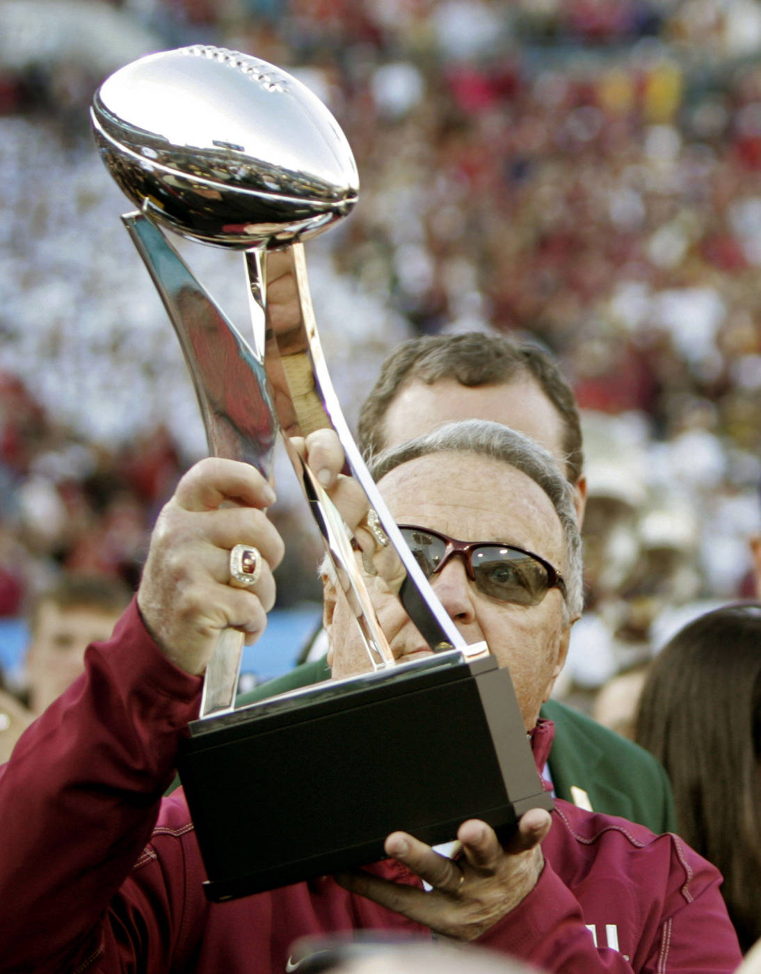Florida State head coach Bobby Bowden holds up the trophy after their 33-21 win over West Virginia in the Gator Bowl NCAA college football game, on Friday, Jan. 1, 2010, in Jacksonville, Fla.(AP Photo/Phil Coale)