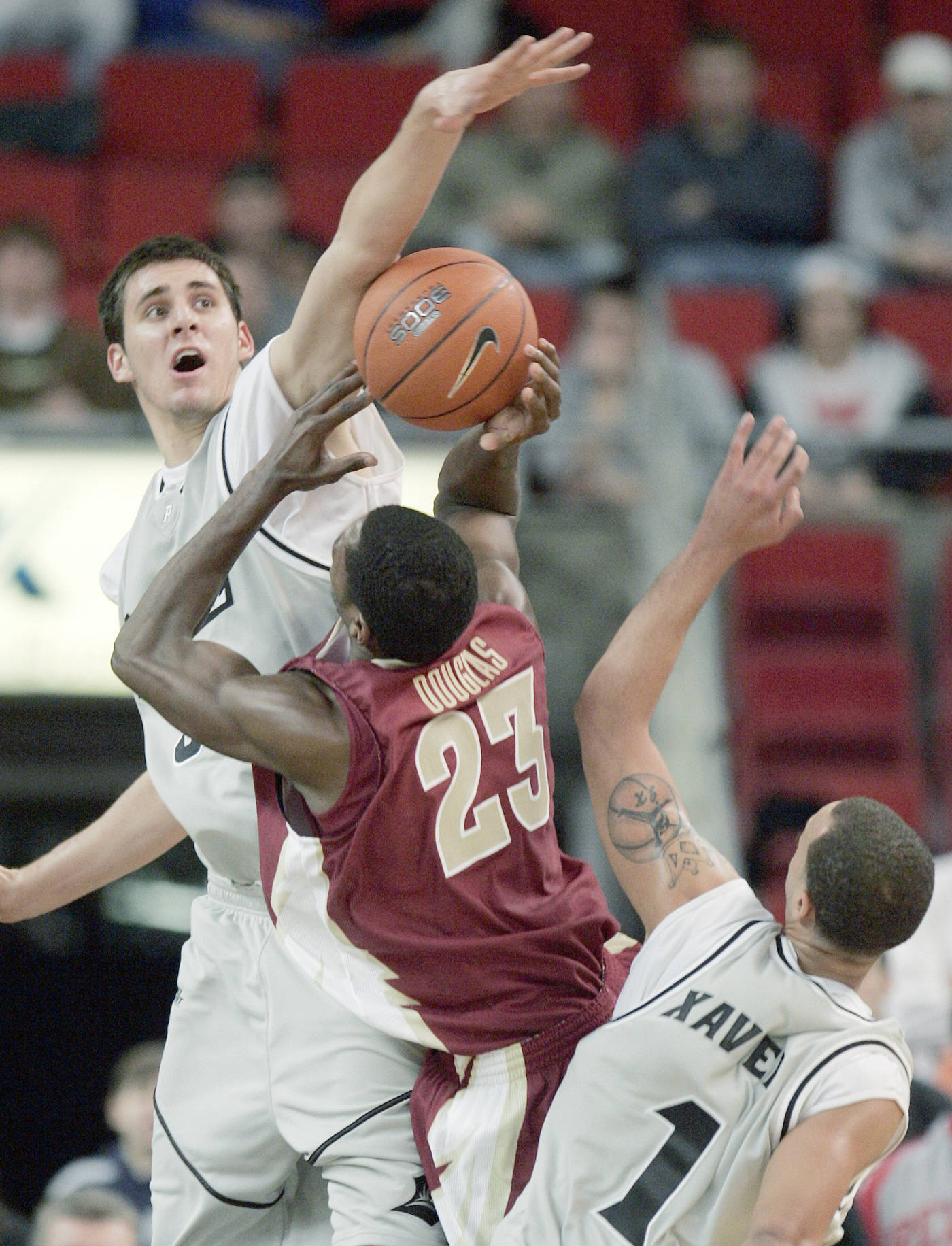 Providence's Randall Hanke blocks a shot by Florida State's Toney Douglas as Providence's Jeff Xavier looks on in the first half.