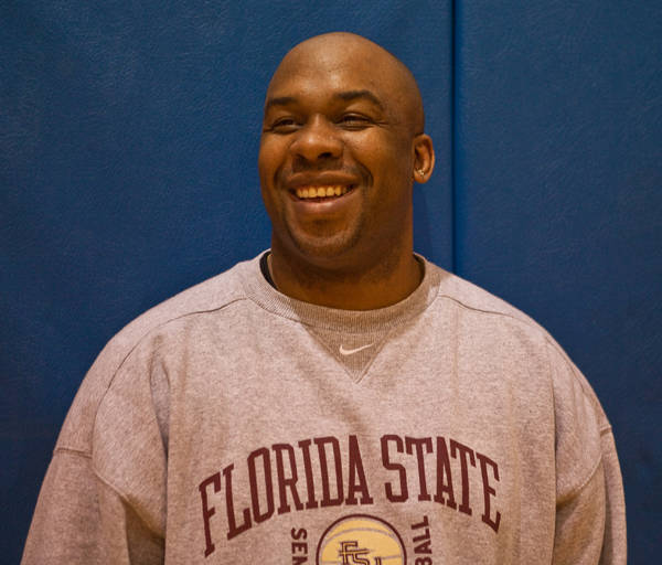 Academic Advisor Marlon Dechausay shares a laugh at the team's afternoon practice.