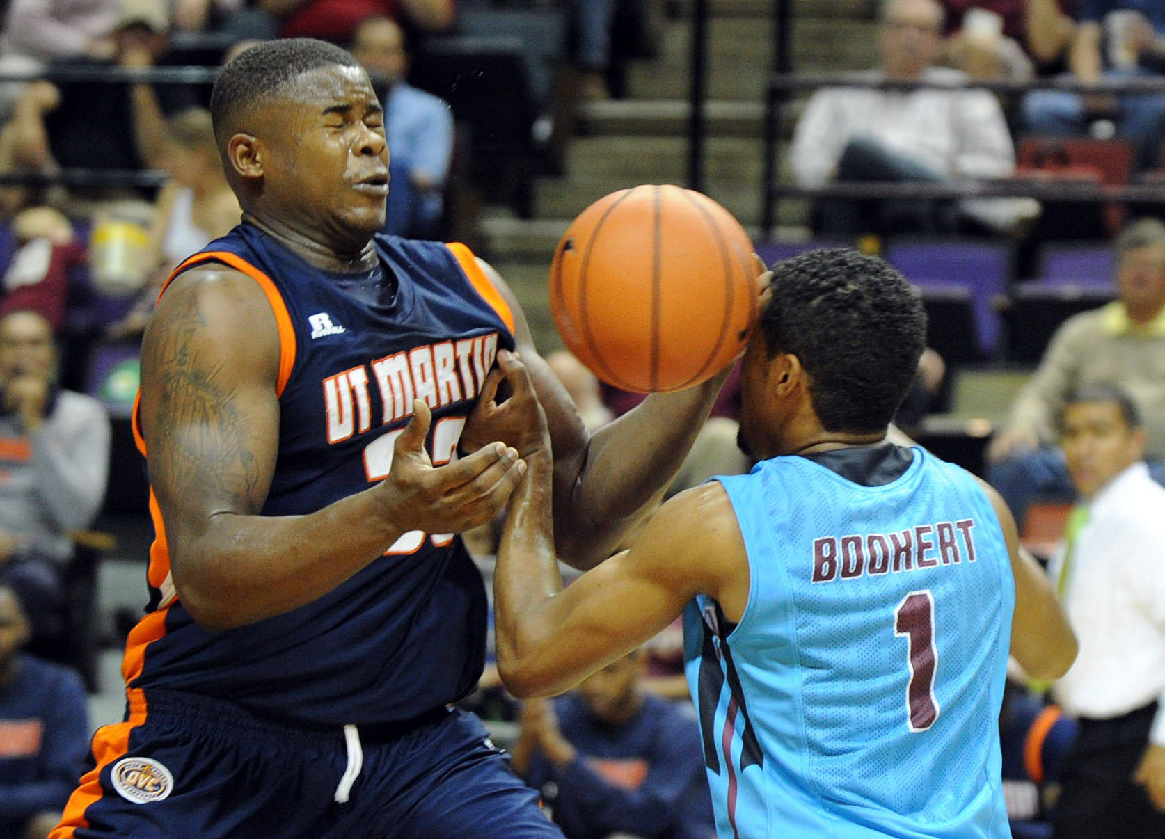 Devon Bookert (1) fights for a loose ball against UT Martin Skyhawks forward Myles Taylor (33). Mandatory Credit: Melina Vastola-USA TODAY Sports