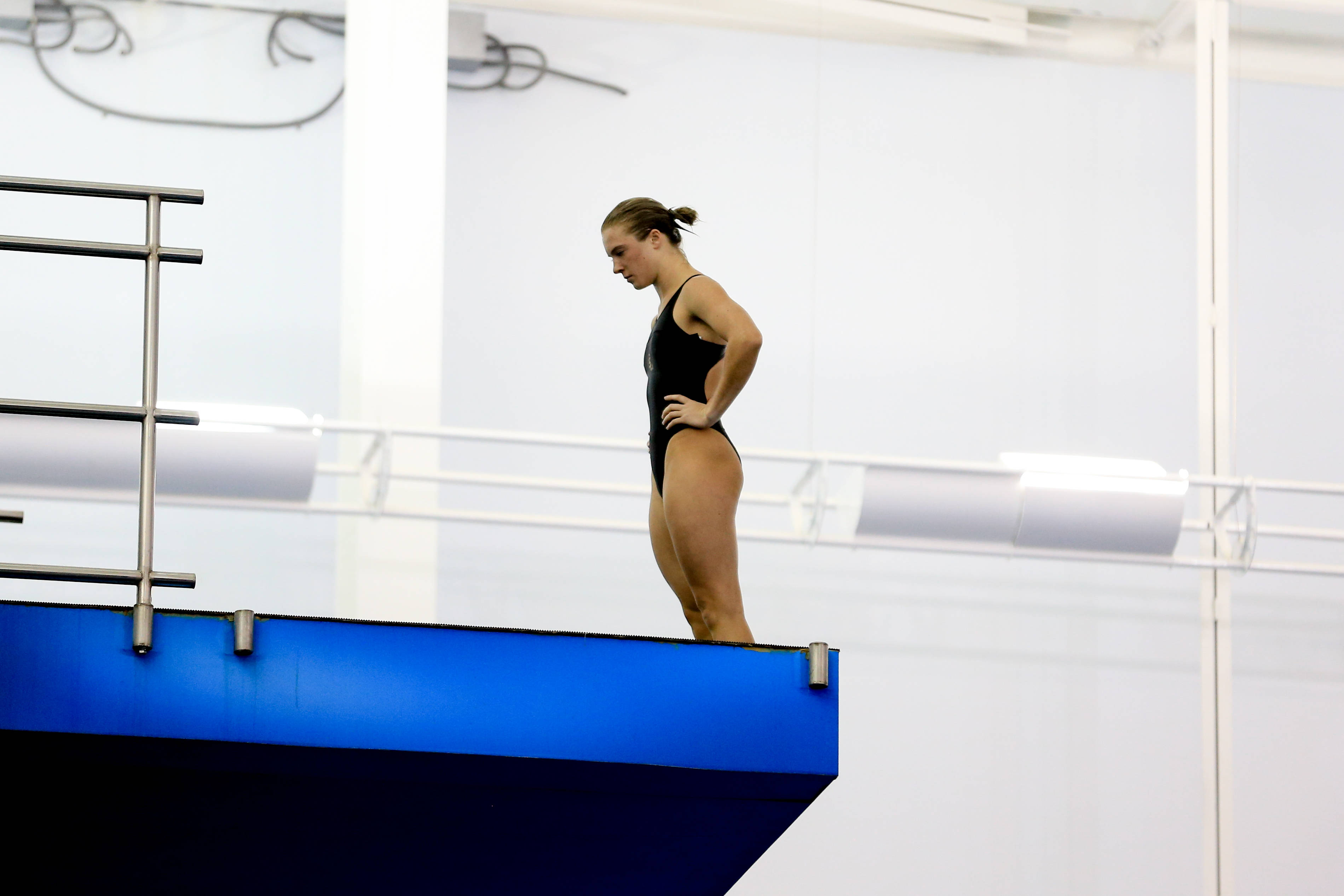 Katrina Young stands clears her head before a dive