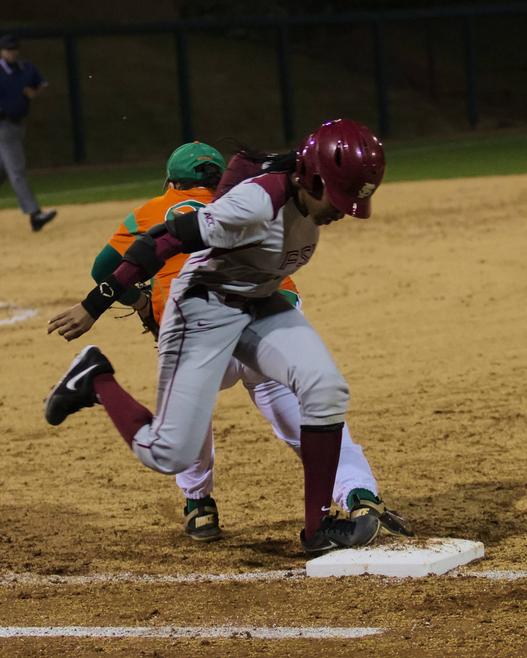 Tiffani Brown (6) beating out an infield hit, FSU vs FAMU, 02/08/13. (Photo by Steve Musco)