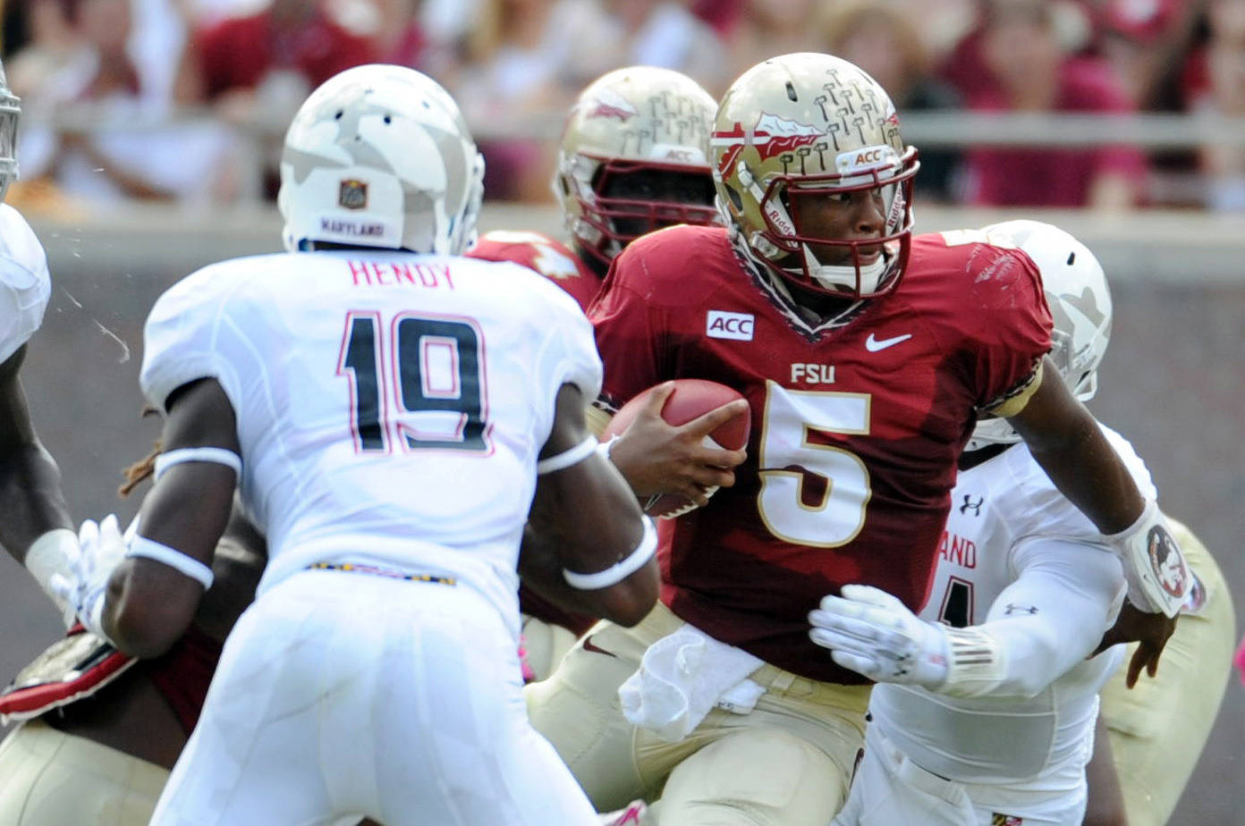 Seminoles quarterback Jameis Winston (5) tries to run past Terrapins defensive back A.J. Hendy (19). Mandatory Credit: Melina Vastola-USA TODAY Sports