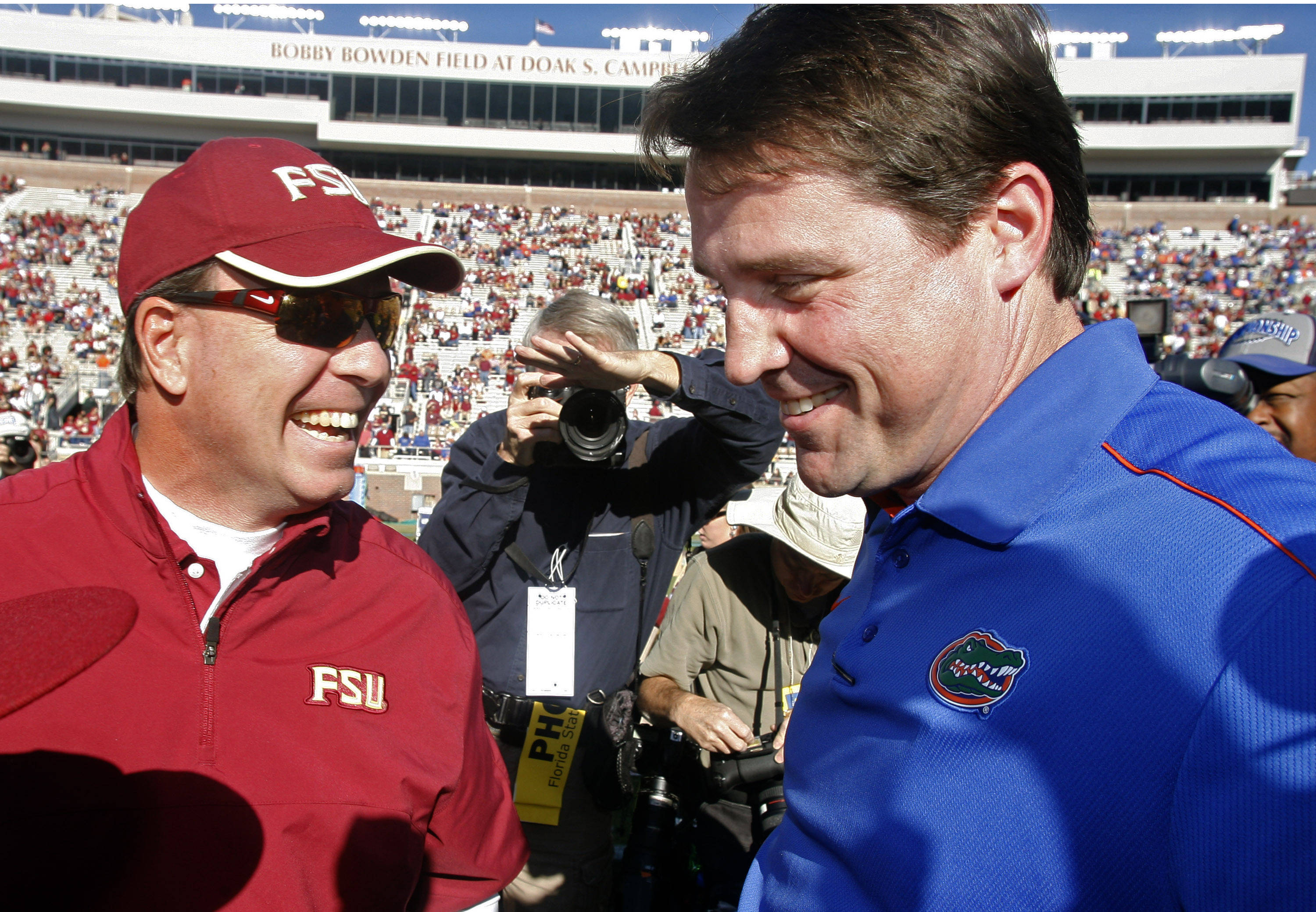 Florida State head coach Jimbo Fisher, left, greets Florida head coach Will Muschamp on the field prior to the game. (AP Photo/Phil Sears)