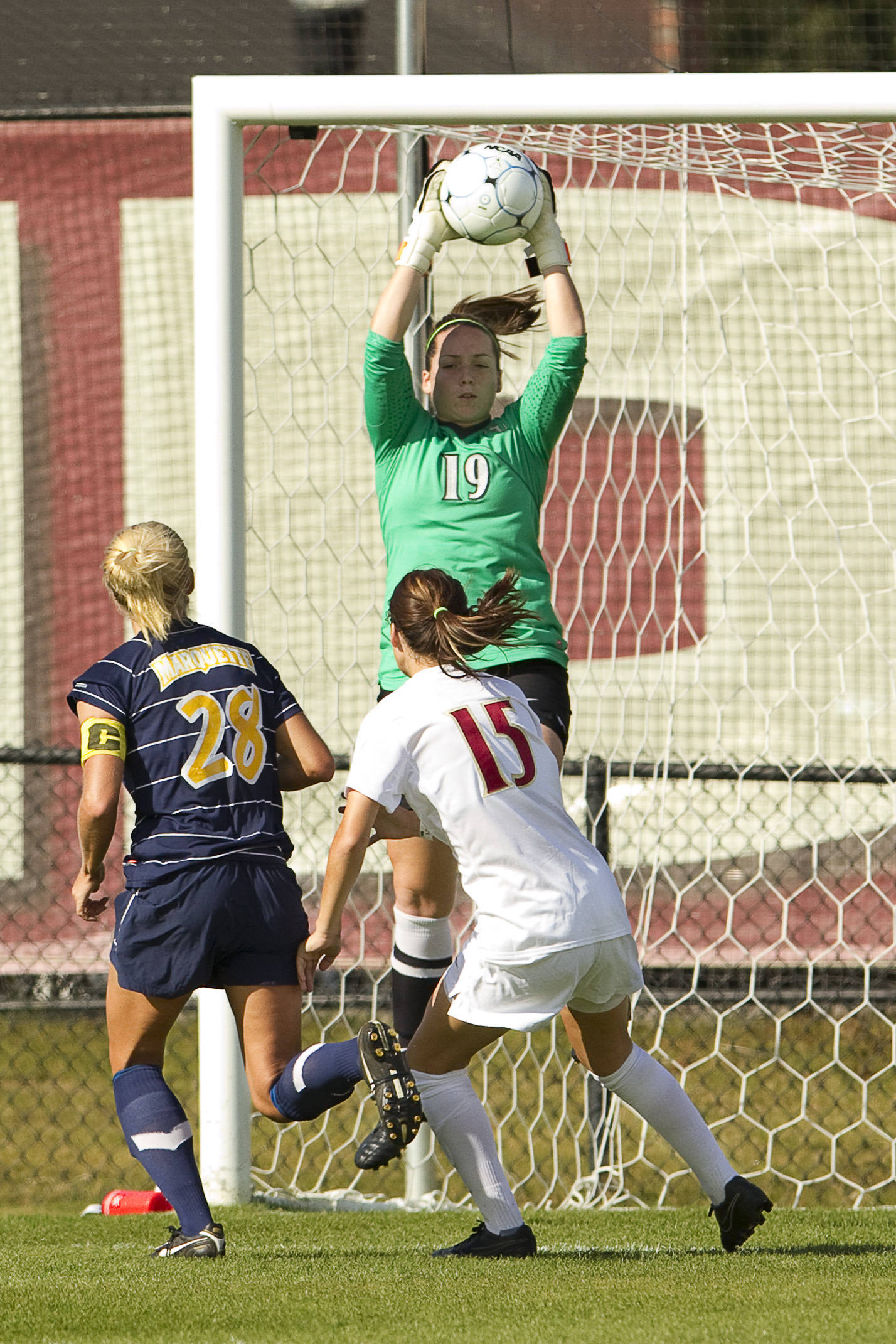FSU Keeper jumps to save a shot from a Marquette offender.