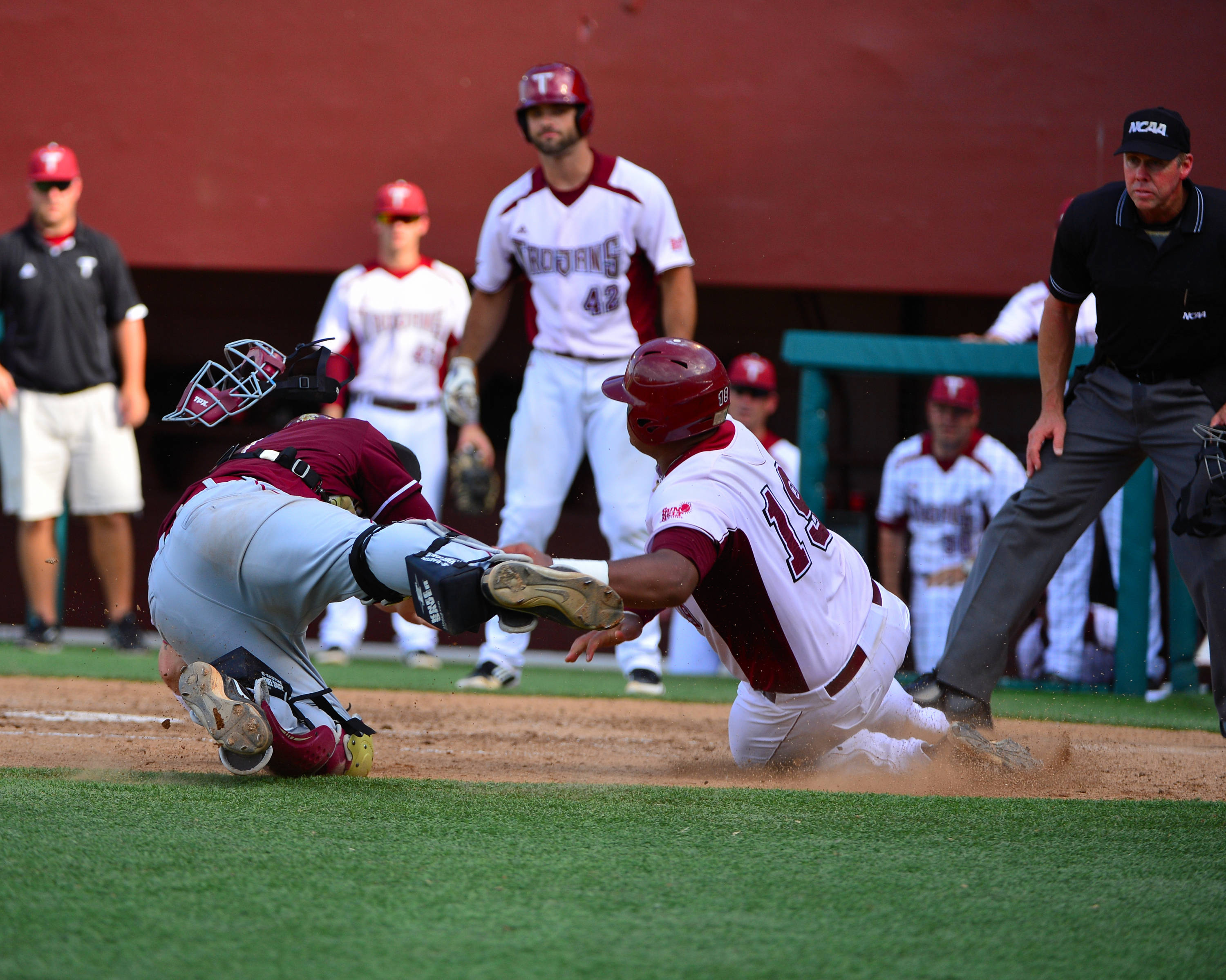 Stephen McGee makes the tag at home in the fourth inning.