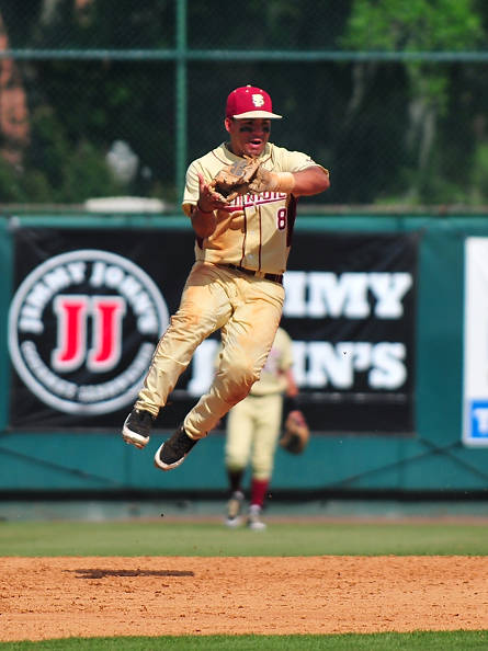 Second baseman Devon Travis leaps to snare a line drive against the Tar Heels.