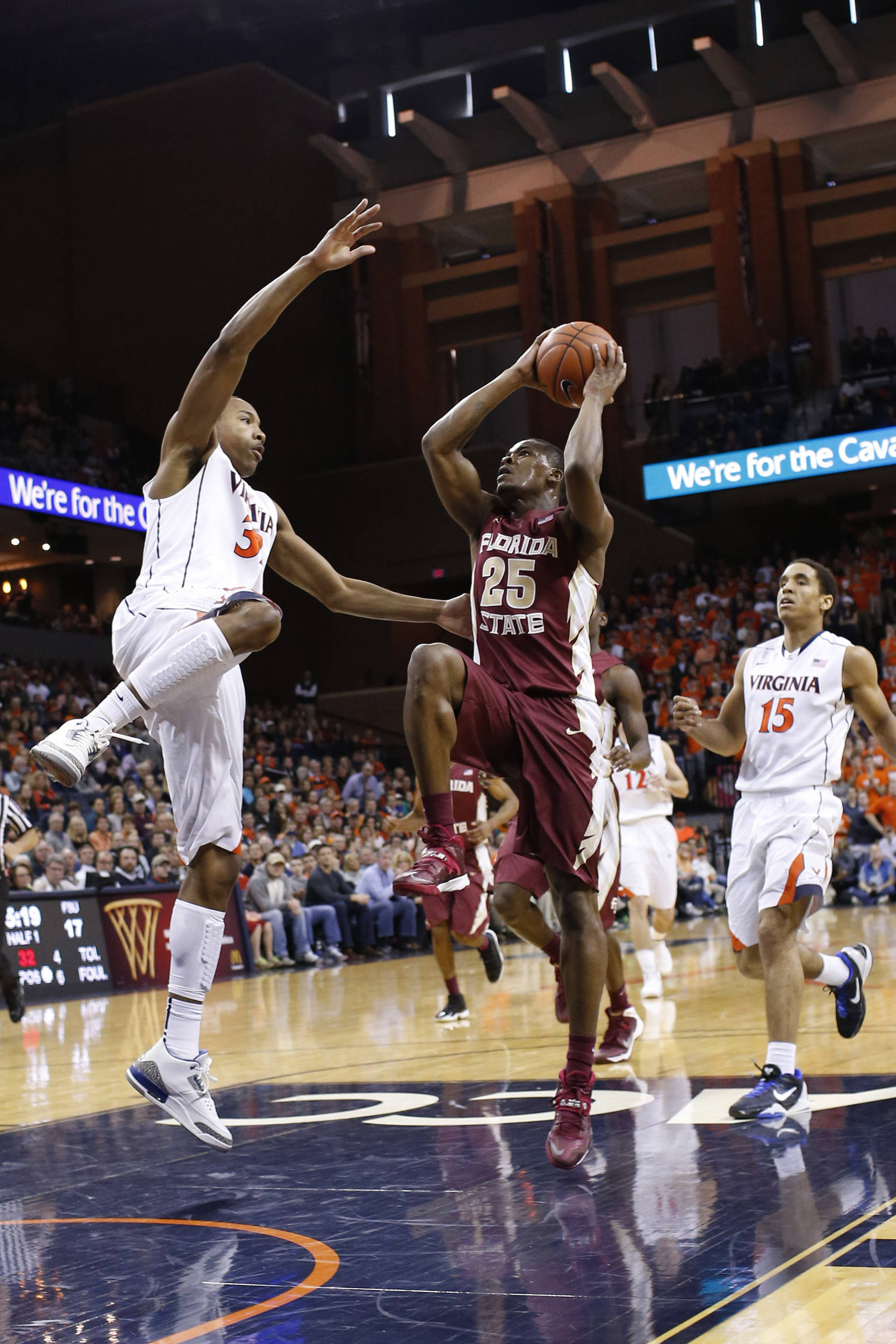 Jan 18, 2014; Charlottesville, VA, USA; Florida State Seminoles guard Aaron Thomas (25) shoots the ball as Virginia Cavaliers forward Darion Atkins (32) defends in the first half at John Paul Jones Arena. Mandatory Credit: Geoff Burke-USA TODAY Sports
