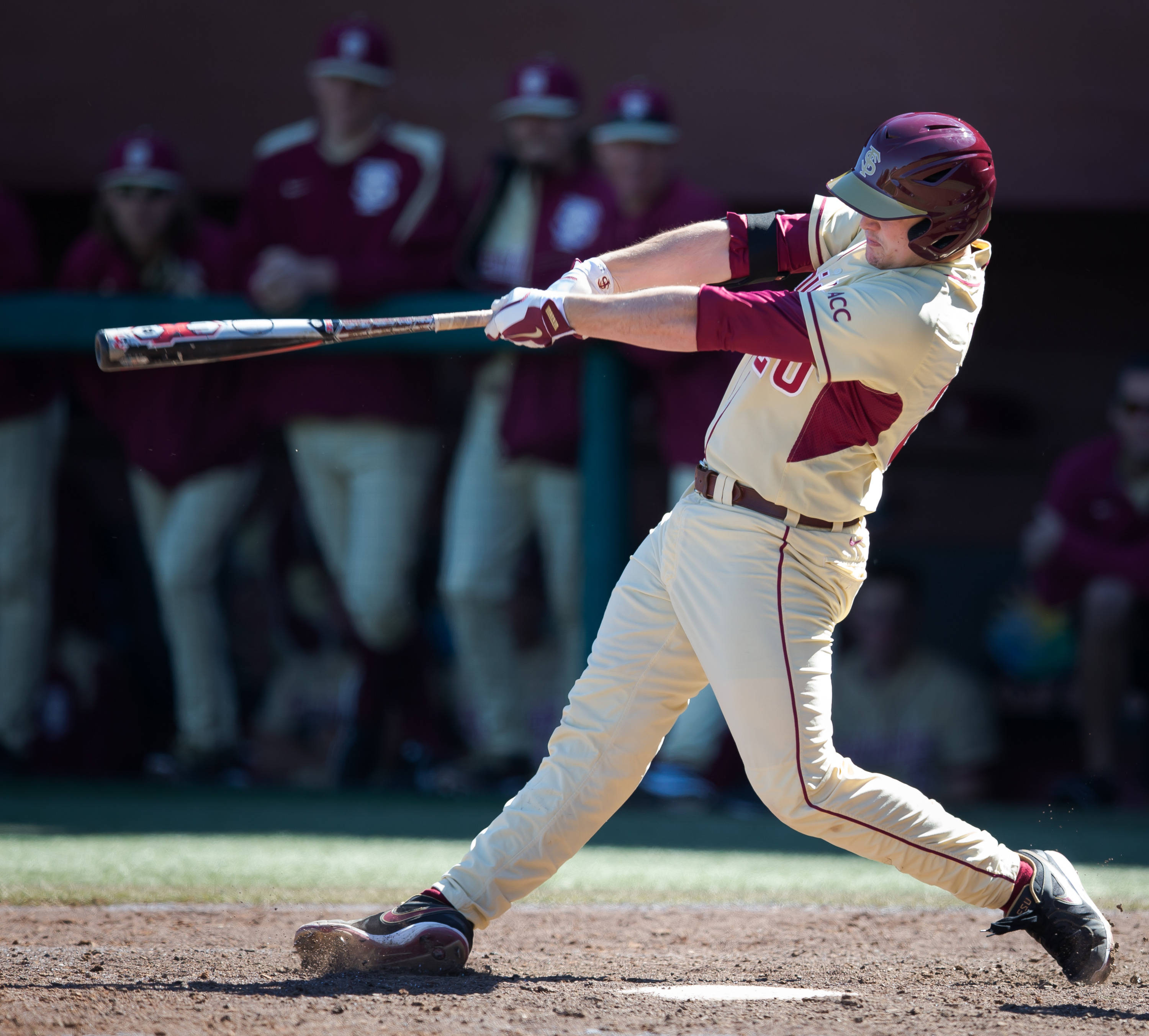 Gage West (20) connects for his first FSU home run.