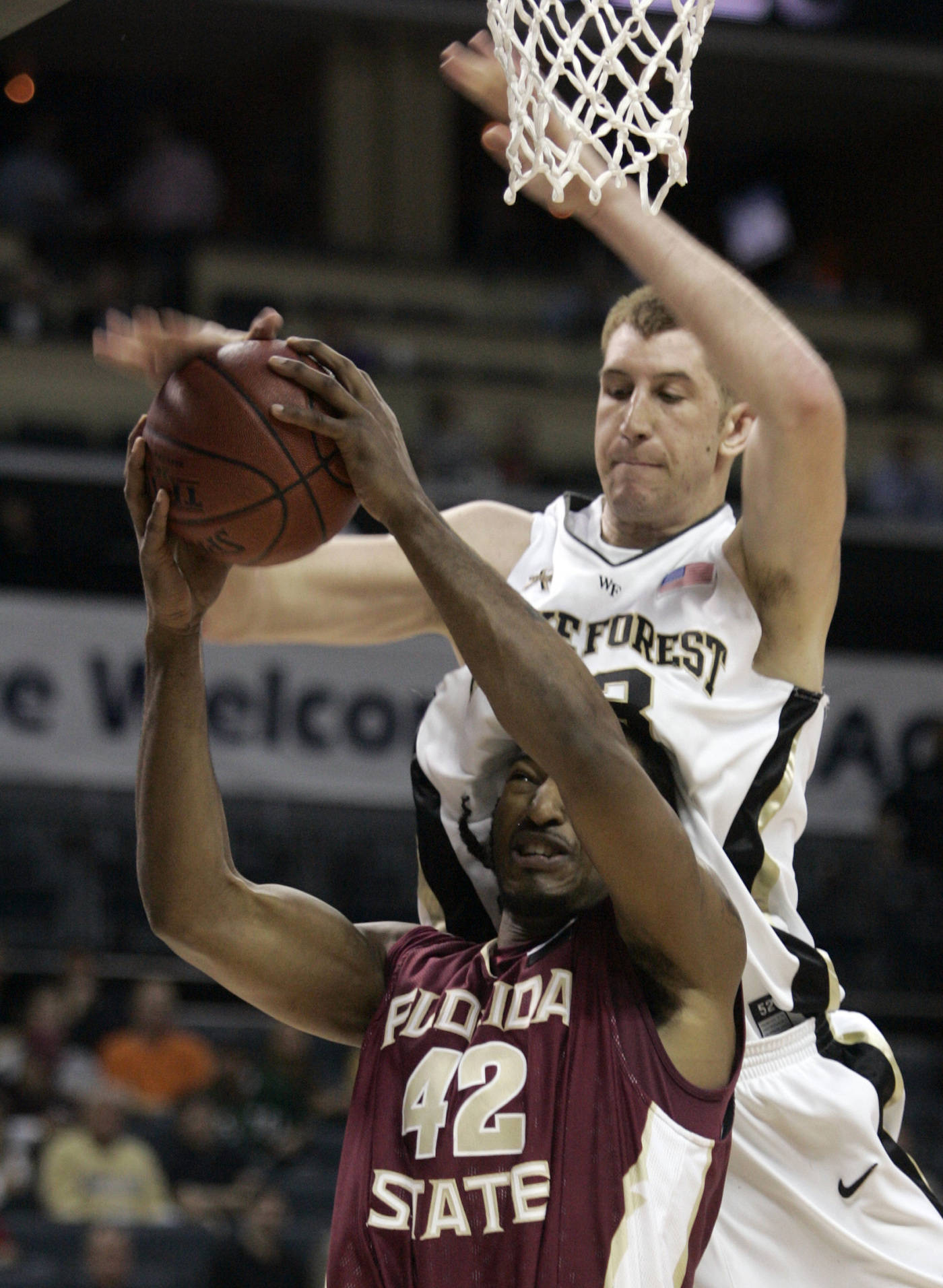 Ryan Reid is fouled by Wake Forest center Chas McFarland in the first half. (AP Photo/Steve Helber)