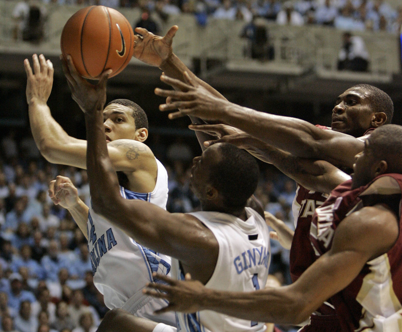 North Carolina's Danny Green, left, and Marcus Ginyard battle with Florida State's Uche Echefu and Jason Rich, right, for a rebound during the first half of a college basketball game in Chapel Hill, N.C., Tuesday, March 4, 2008. (AP Photo/Gerry Broome)
