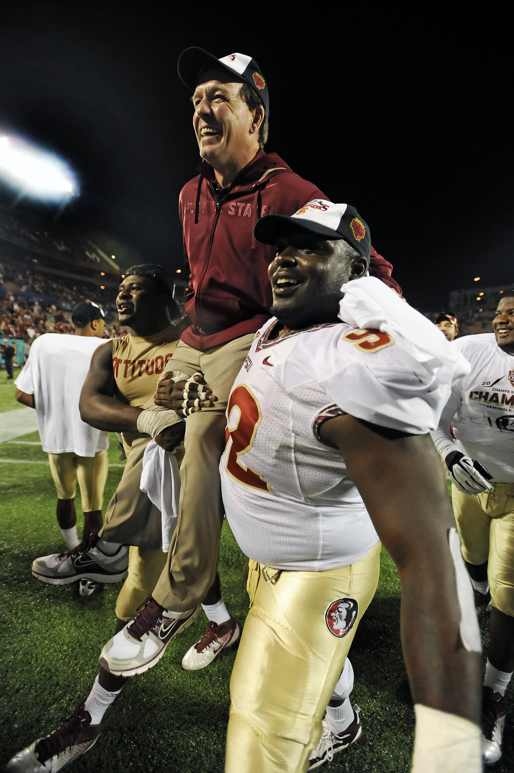 Jimbo Fisher celebrates with players after defeating Notre Dame in the 2011 Champs Sports Bowl.  It marked FSU's record 30th consecutive bowl game appearance.