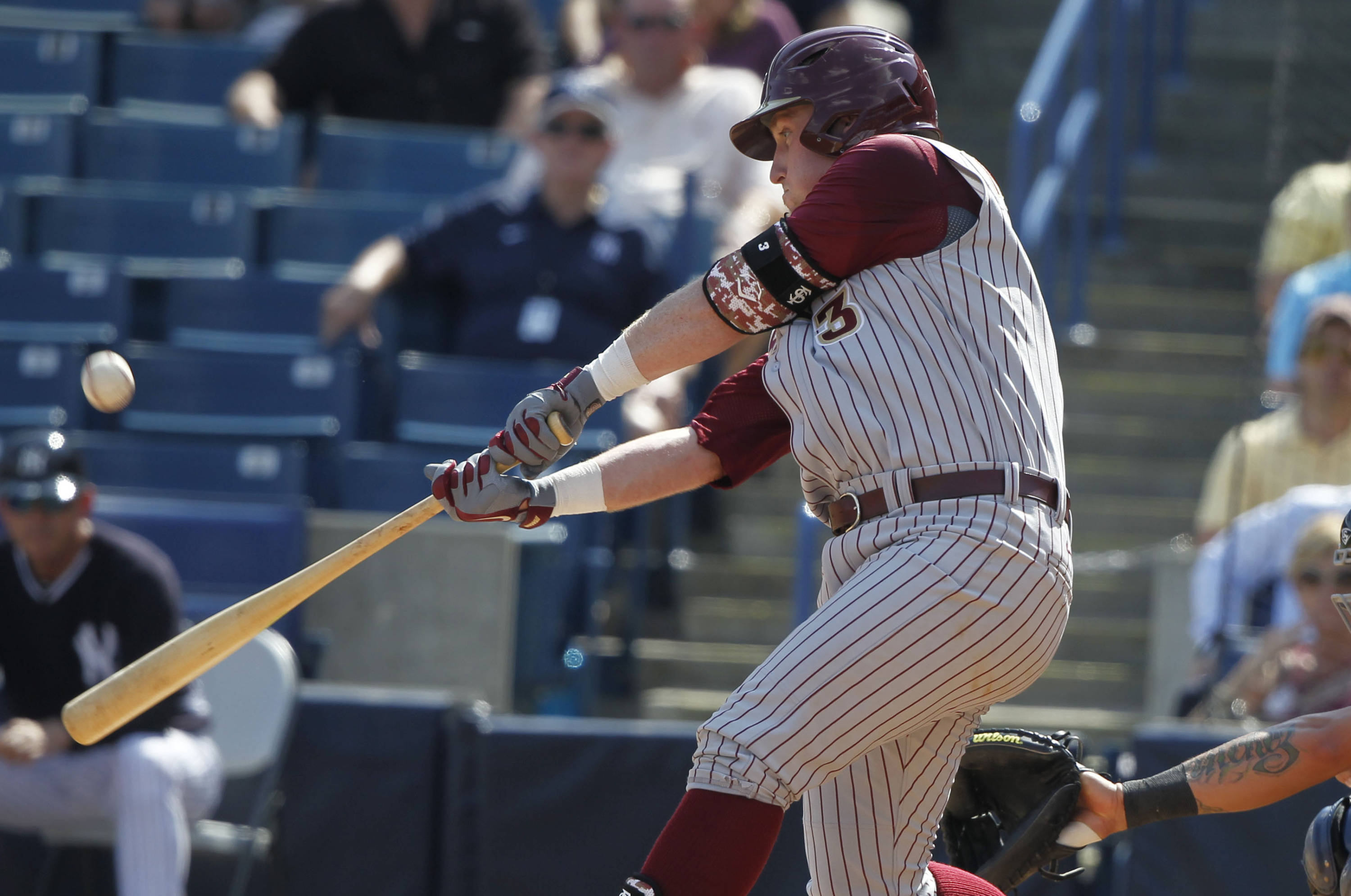 Feb 25, 2014; Tampa, FL, USA; Florida State Seminoles first baseman John Nogowski (3) hits against the New York Yankees during the fourth inning at George M. Steinbrenner Field. Mandatory Credit: Kim Klement-USA TODAY Sports