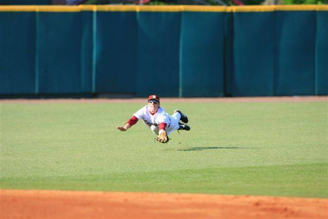 Tyler Holt makes a diving grab in centerfield for the third out in the first inning.