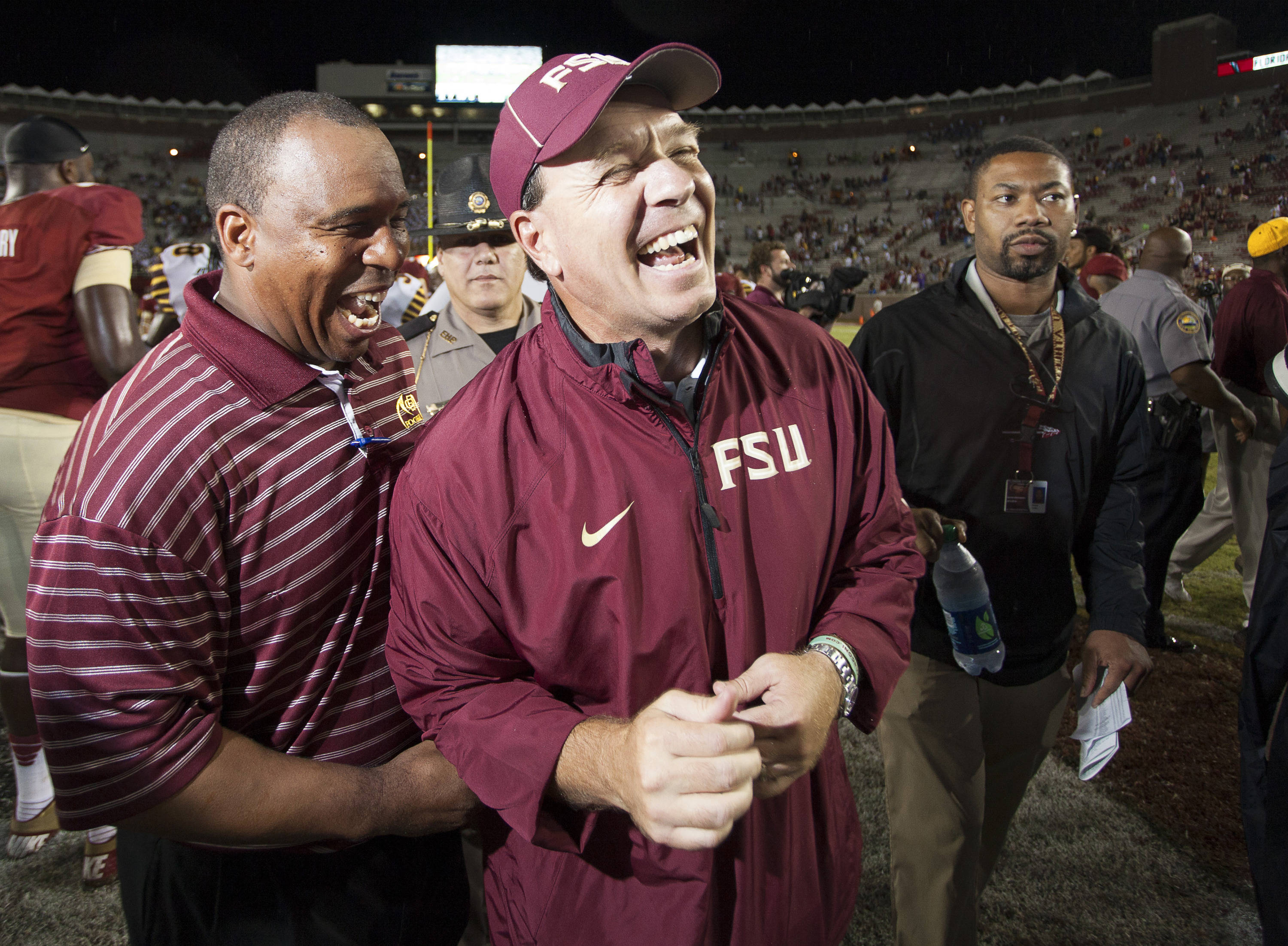Jimbo Fisher jokes with a Bethune-Cookman coach after FSU Football's 54-6 win over Bethune-Cookman on September 21, 2013 in Tallahassee, Fla