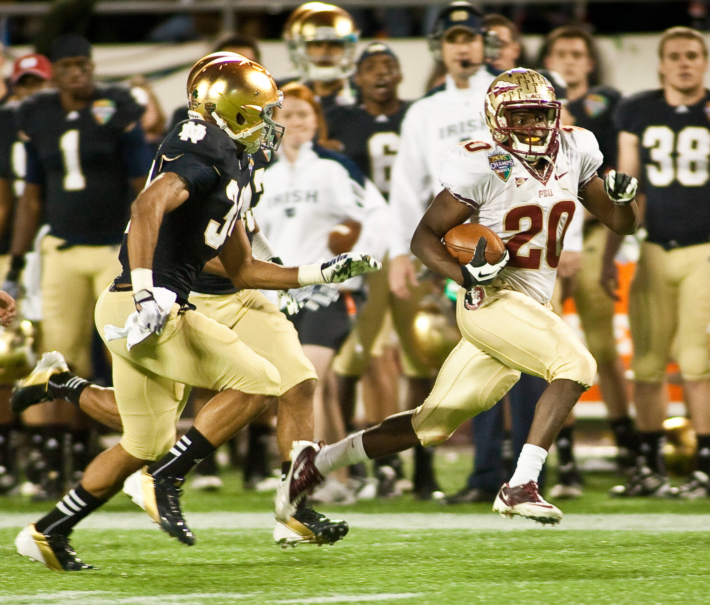 Lamarcus Joyner (20) with a long kickoff return that sparked the Seminoles' victory over Notre Dame in the Champs Sports Bowl.
