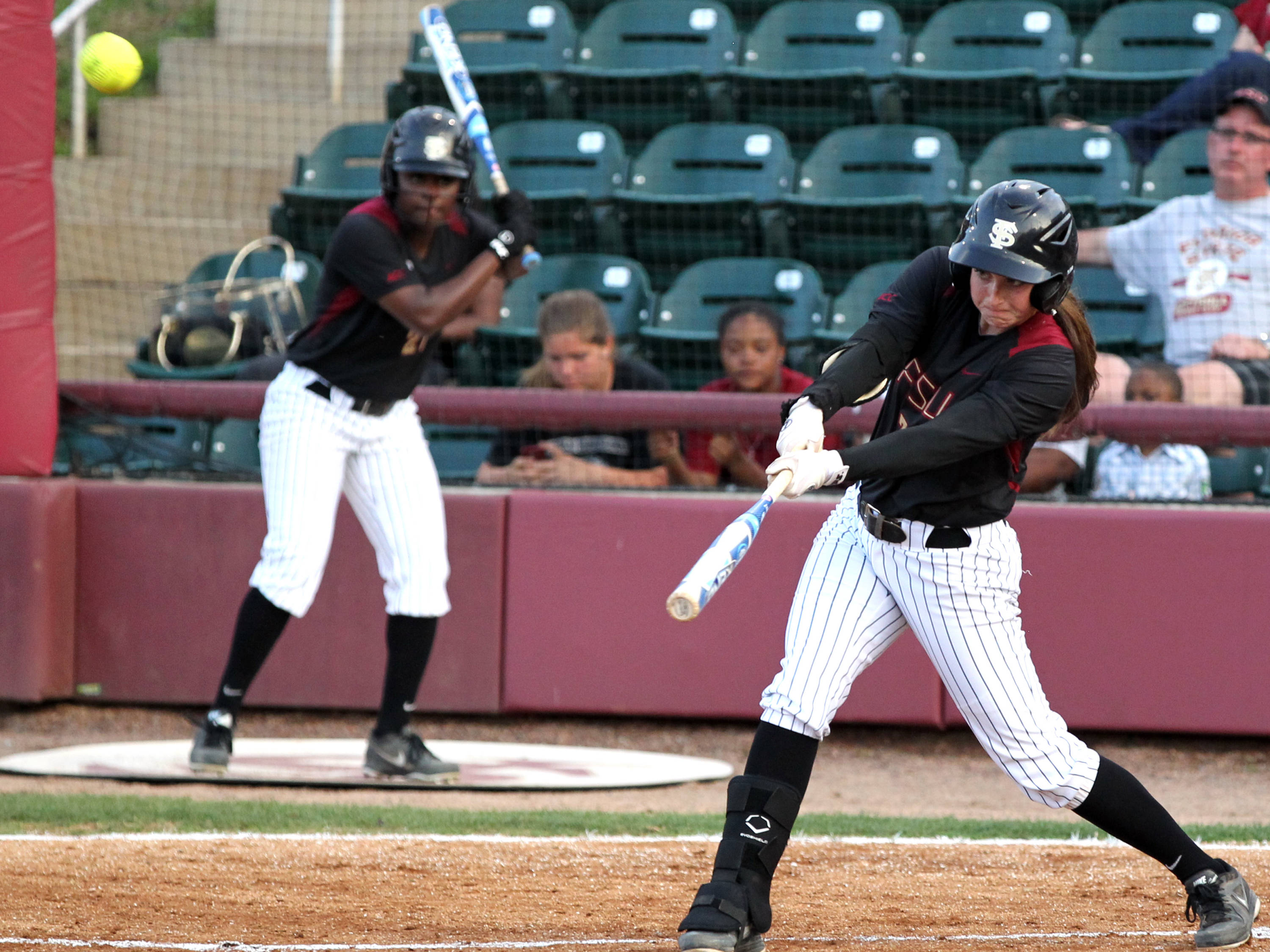 Maddie O' Brien launching her solo home run, FSU vs Virginia, 04/13/13 . (Photo by Steve Musco)