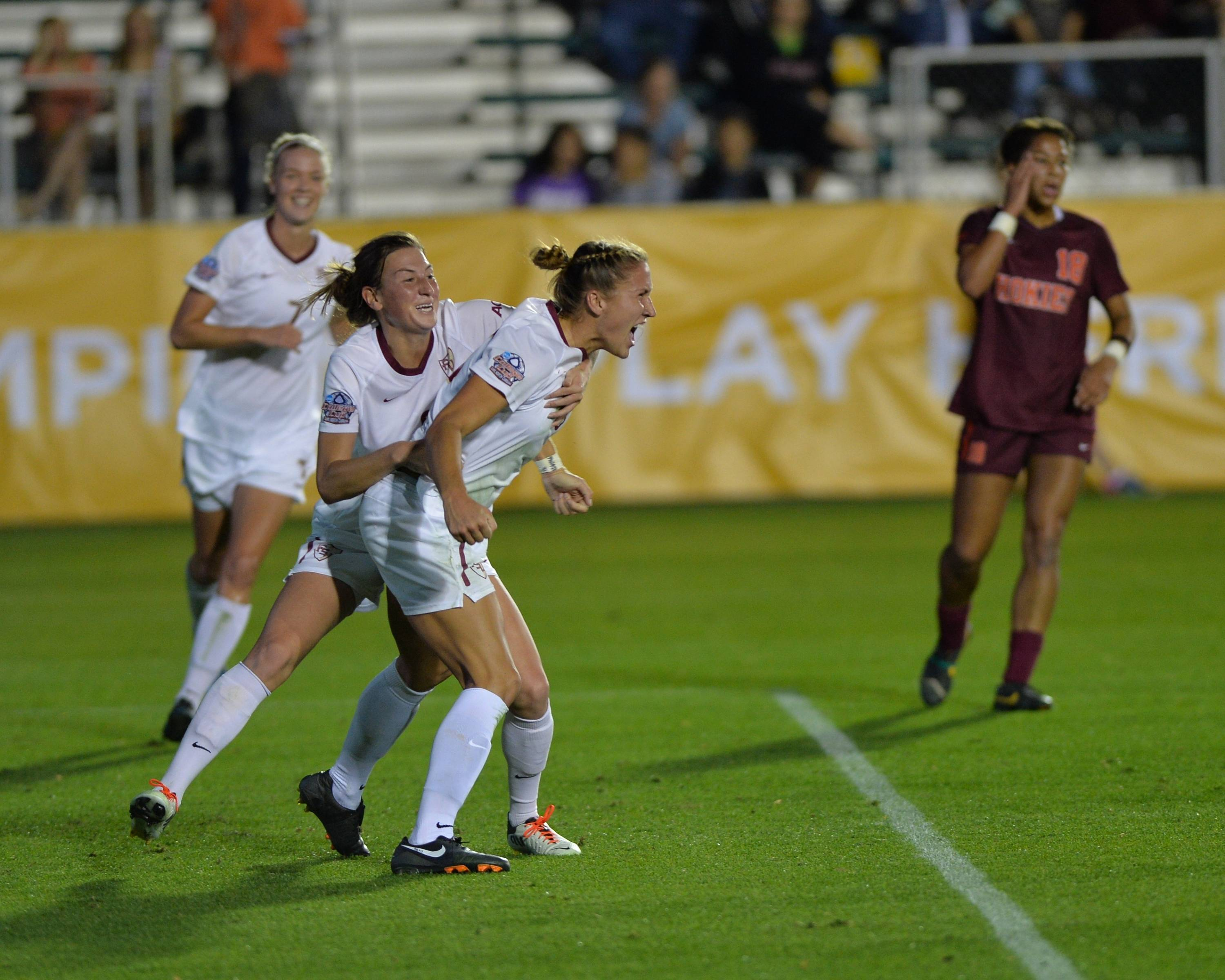 Kassey Kallman celebrates with Kristin Grubka after scoring a goal to tie the match right before halftime.
