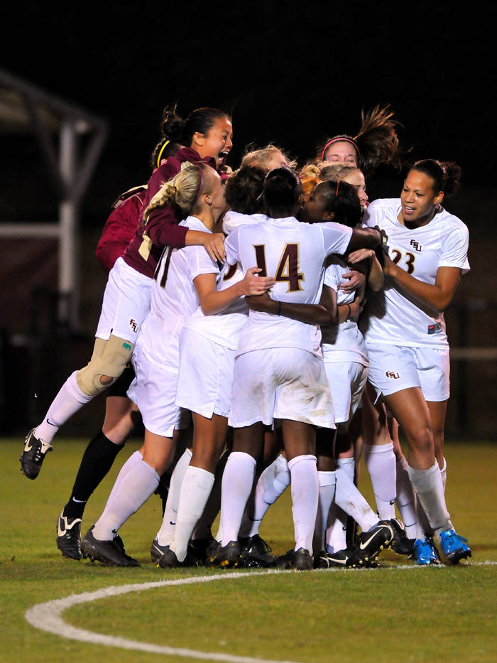 The Seminoles celebrate following Jessica Price's game-winner in the 108th minute.